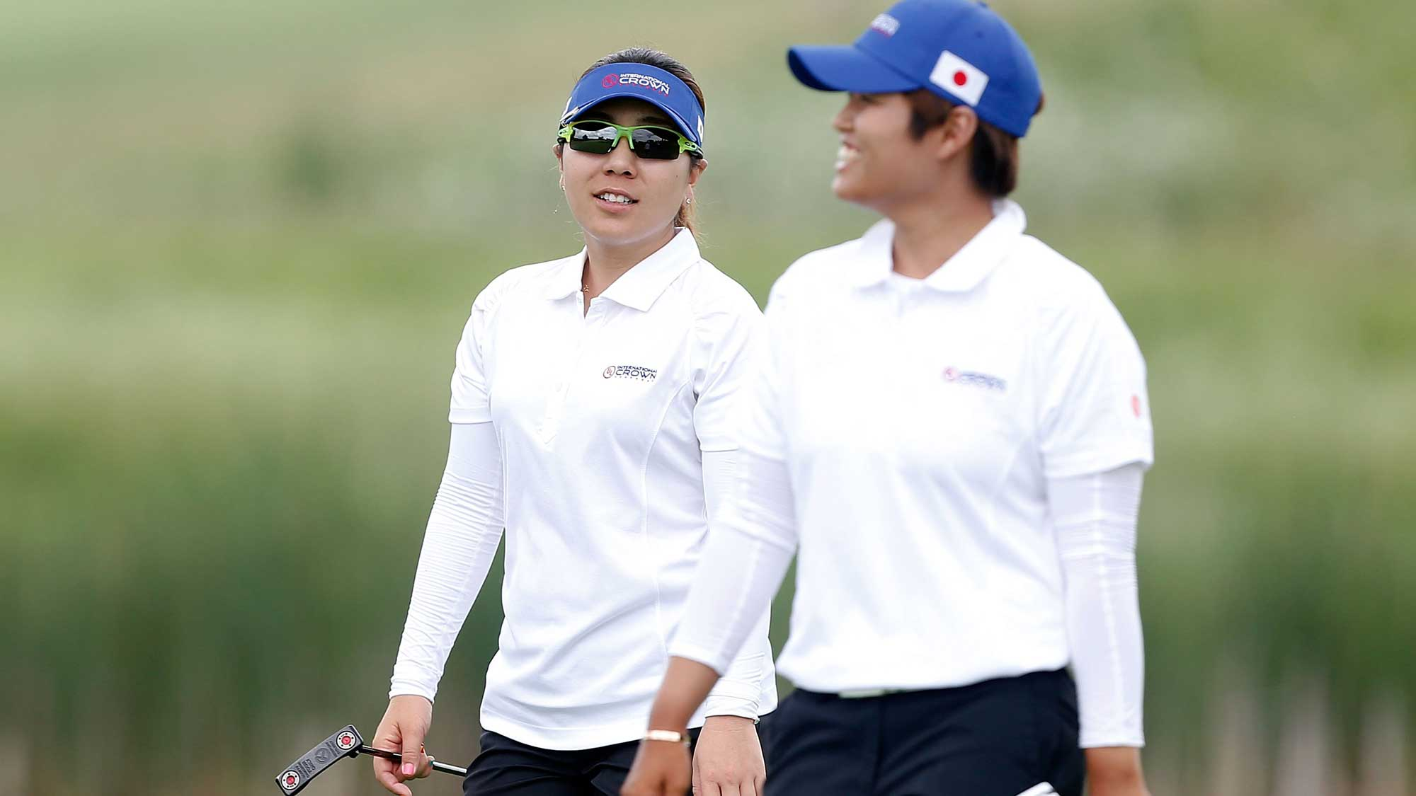 (L) Mika Miyazato and (R) Haru Nomura of Japan walk down the fourth fairway during the four-ball session of the 2016 UL International Crown