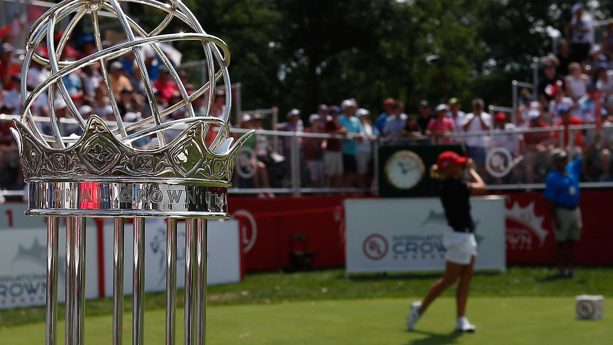 A detailed view of the championship trophy as Stacy Lewis of the United States hits her tee shot on the first hole during the singles matches of the 2016 UL International Crown