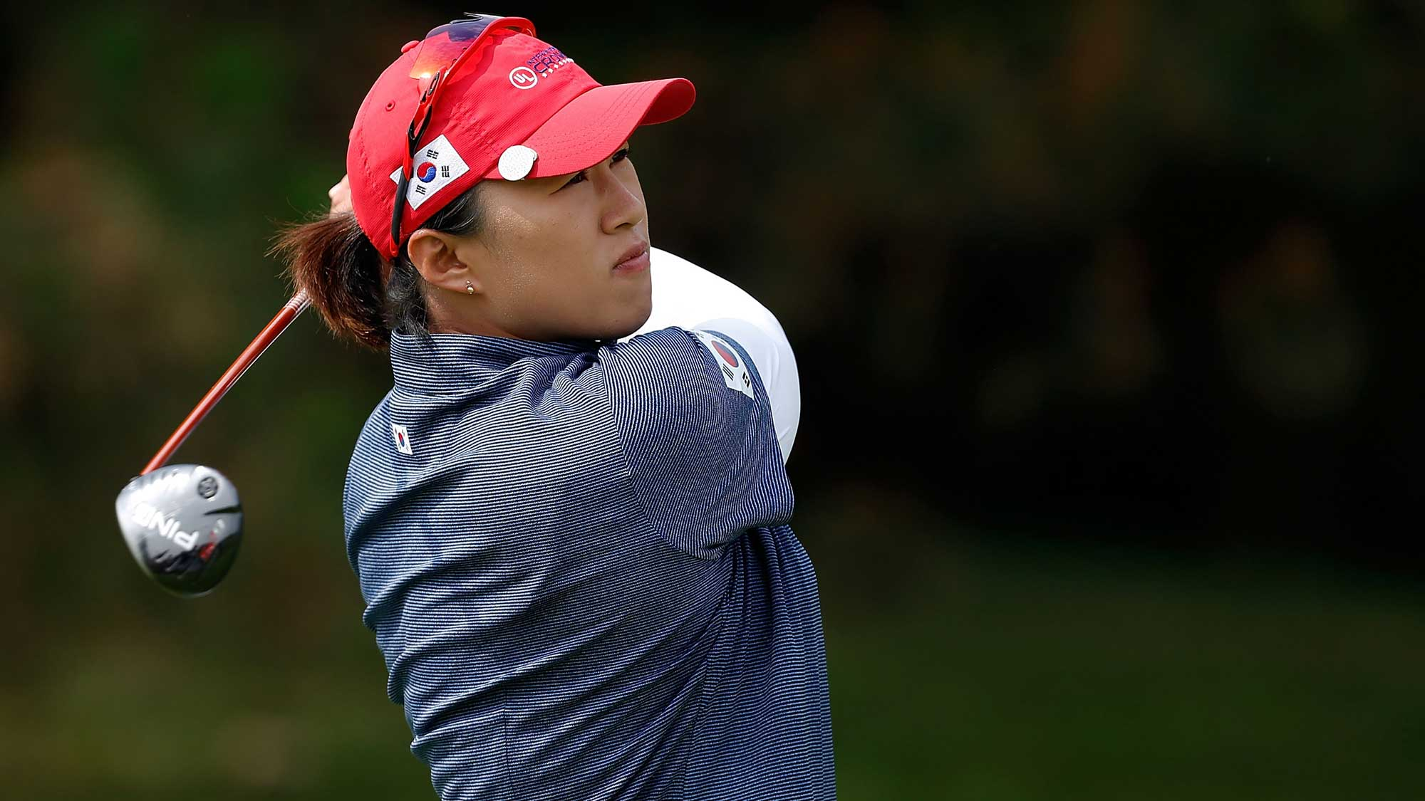 Amy Yang of Korea hits her tee shot on the third hole during the four-ball session of the 2016 UL International Crown at the Merit Club