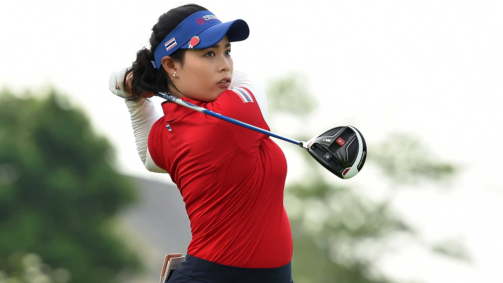 Moriya Jutanugarn of Thailand hits her tee shot on the fourth hole during the four-ball session of the 2016 UL International Crown
