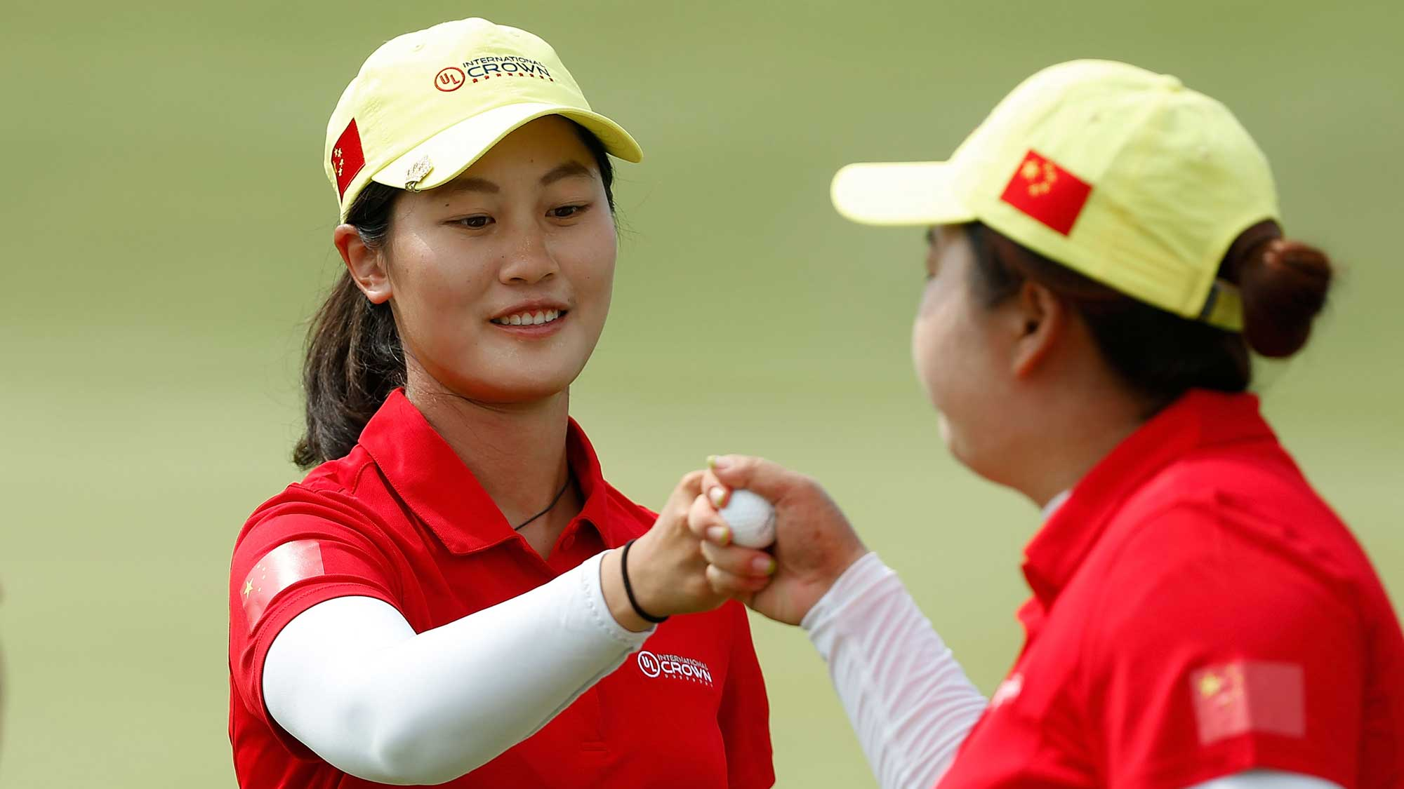 Yu Lin (L) and Shanshan Feng of China celebrate on the third hole during the four-ball session of the 2016 UL International Crown