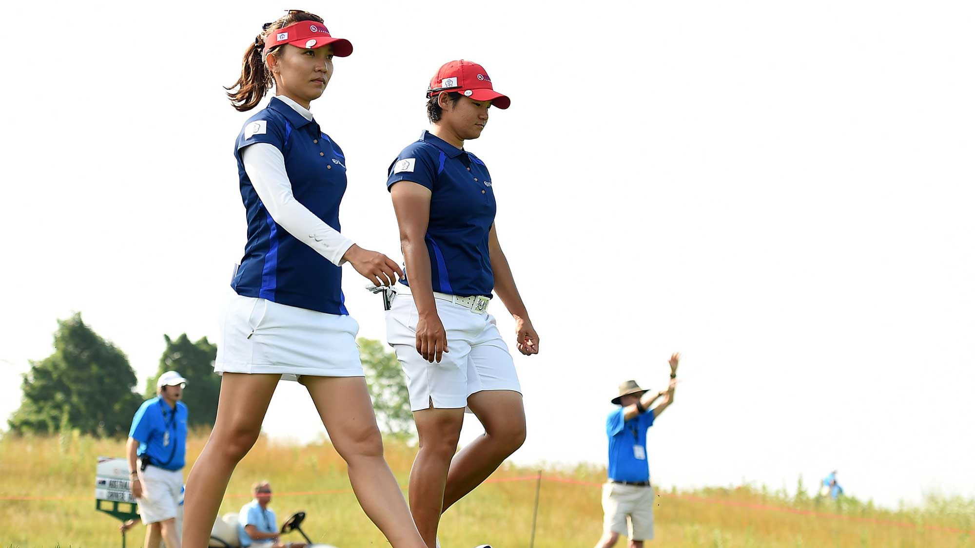 (L) Teresa Lu and (R) Yani Tseng of Chinese Taipei walk off the fourth tee during the four-ball session of the 2016 UL International Crown