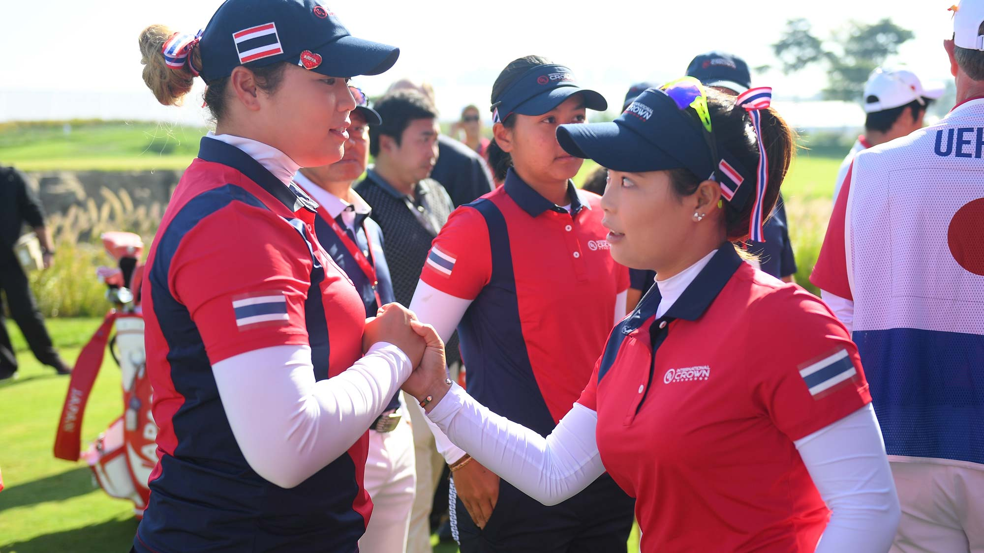Ariya Jutanugarn (L) and Moriya Jutanugarn (R) of Thailand shake hands prior to the Pool B match between Japan and Thailand on day one of the UL International Crown