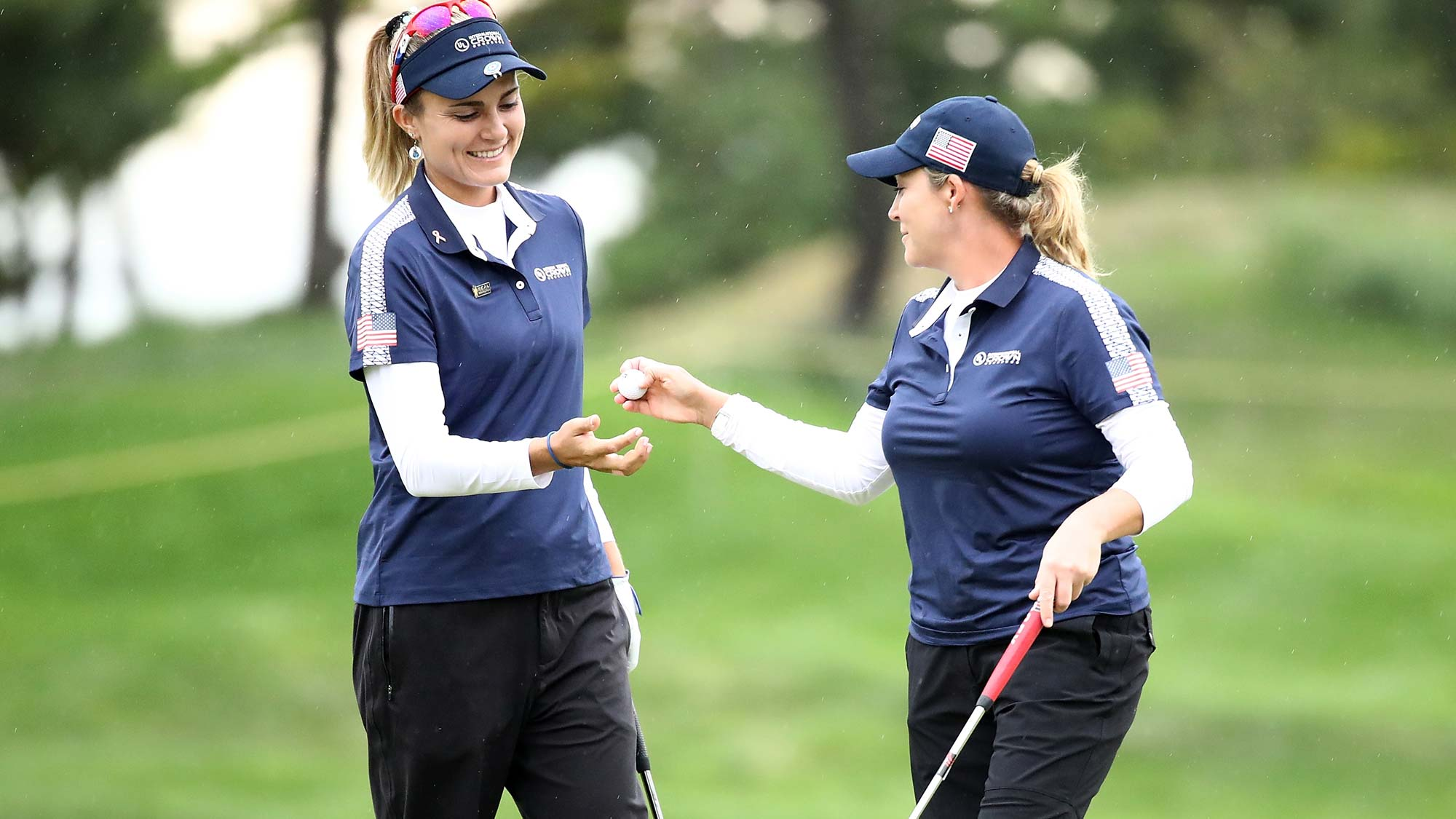 Lexi Thompson (L) and Cristie Kerr (R) of the United States celebrate on the 2nd green during the Pool B match between USA and Thailand on day two of the UL International Crown