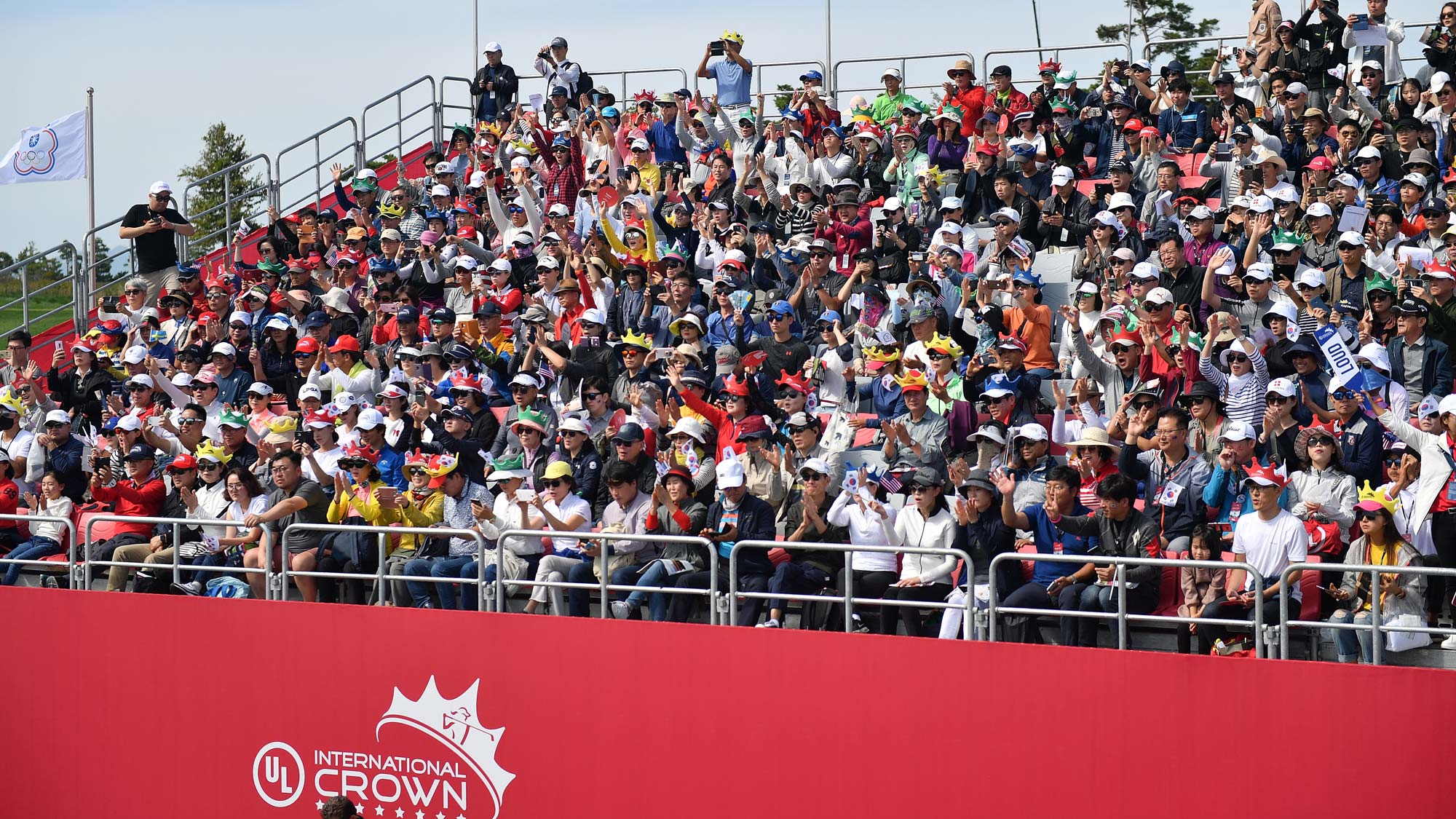 Fans watch on the stand on day four of the UL International Crown