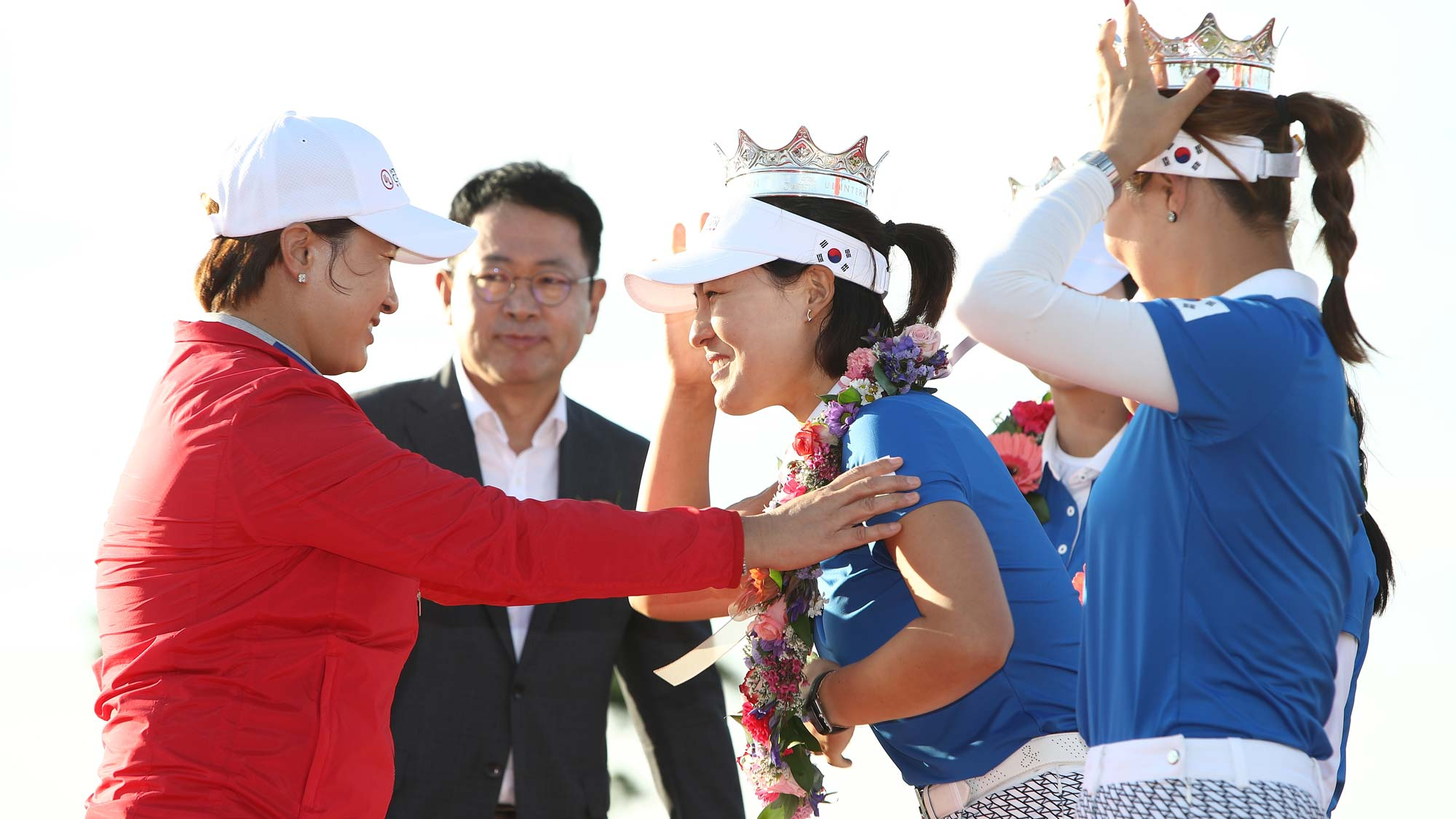 In Gee Chun of South Korea is crowned by Korean golf legend, Se Ri Pak, during the victory ceremony after winning the UL International Crown