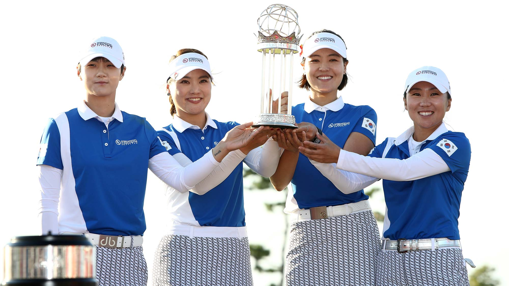 (L go R) Sung Hyun Park, So Yoen Ryu, In Gee Chun and In-Kyung Kim of South Korea pose for photographs with the trophy after winning the UL International Crown