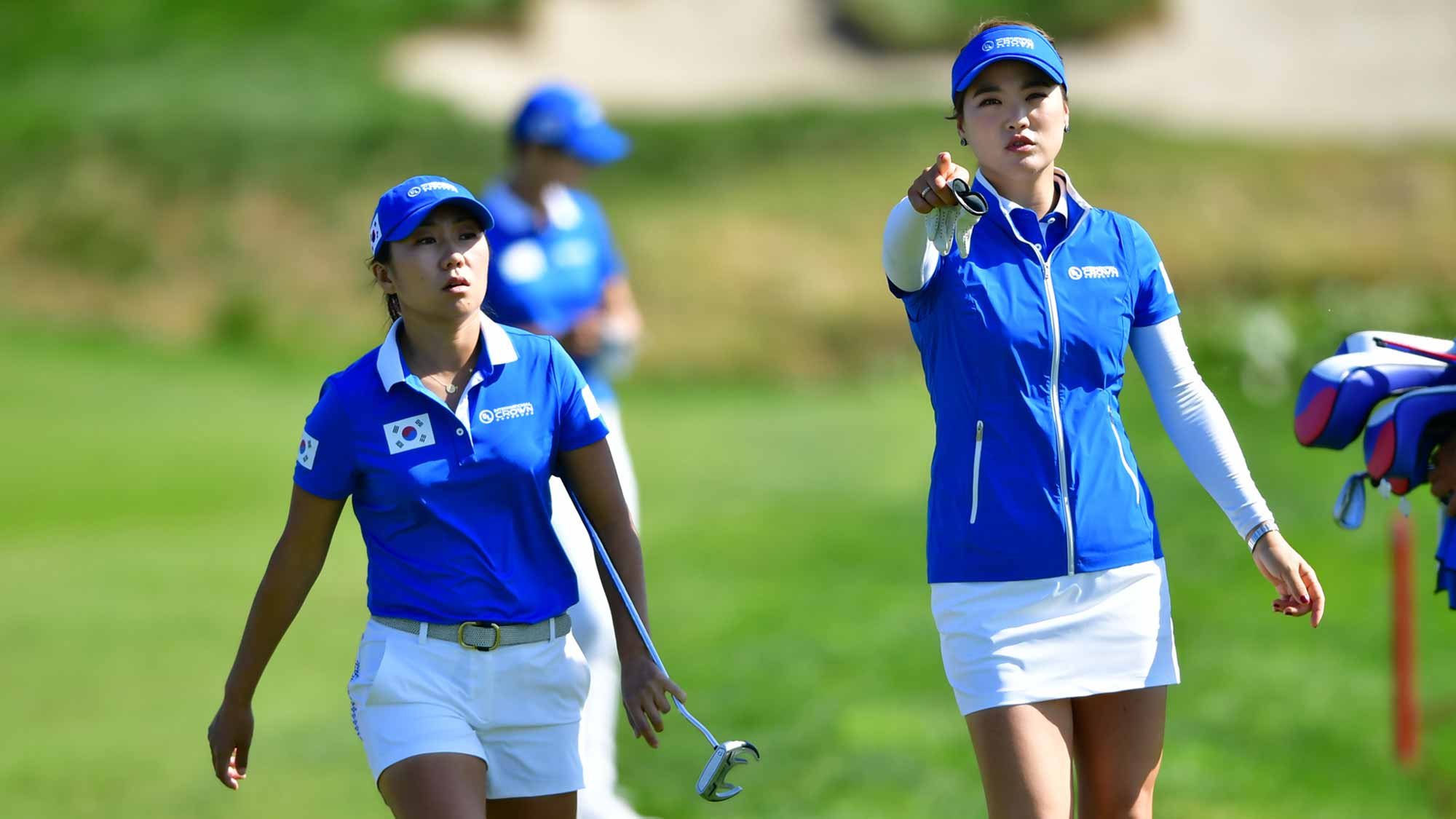 In-Kyung Kim and So Yeon Ryu walk together during the Tuesday practice round at the UL International Crown at Jack Nicklaus Golf Club Korea