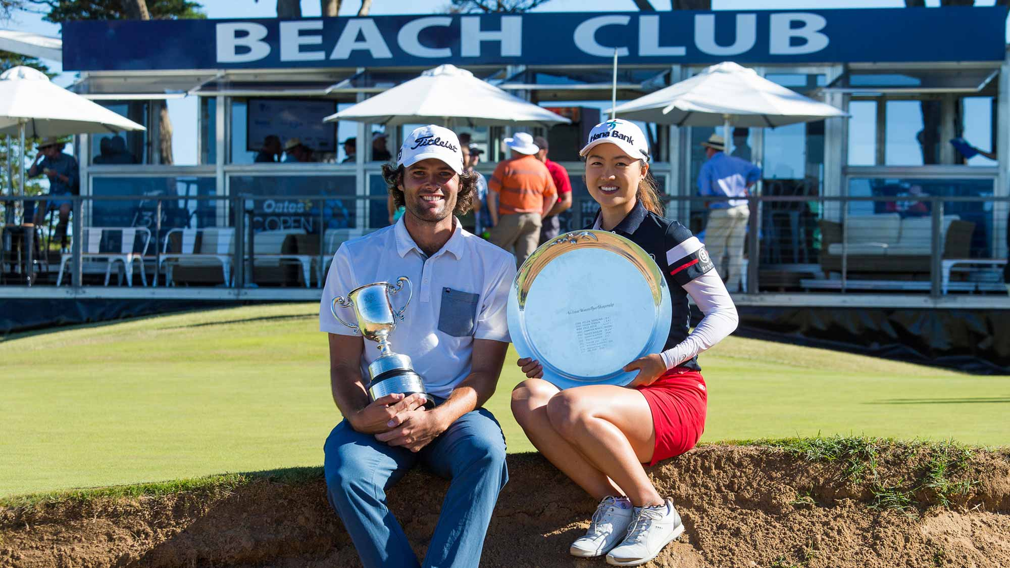 Minjee Lee and Simon Hawkes pose with their trophies after winning the 2018 Vic Open at Beach Golf Links in Geelong, Victoria, Australia