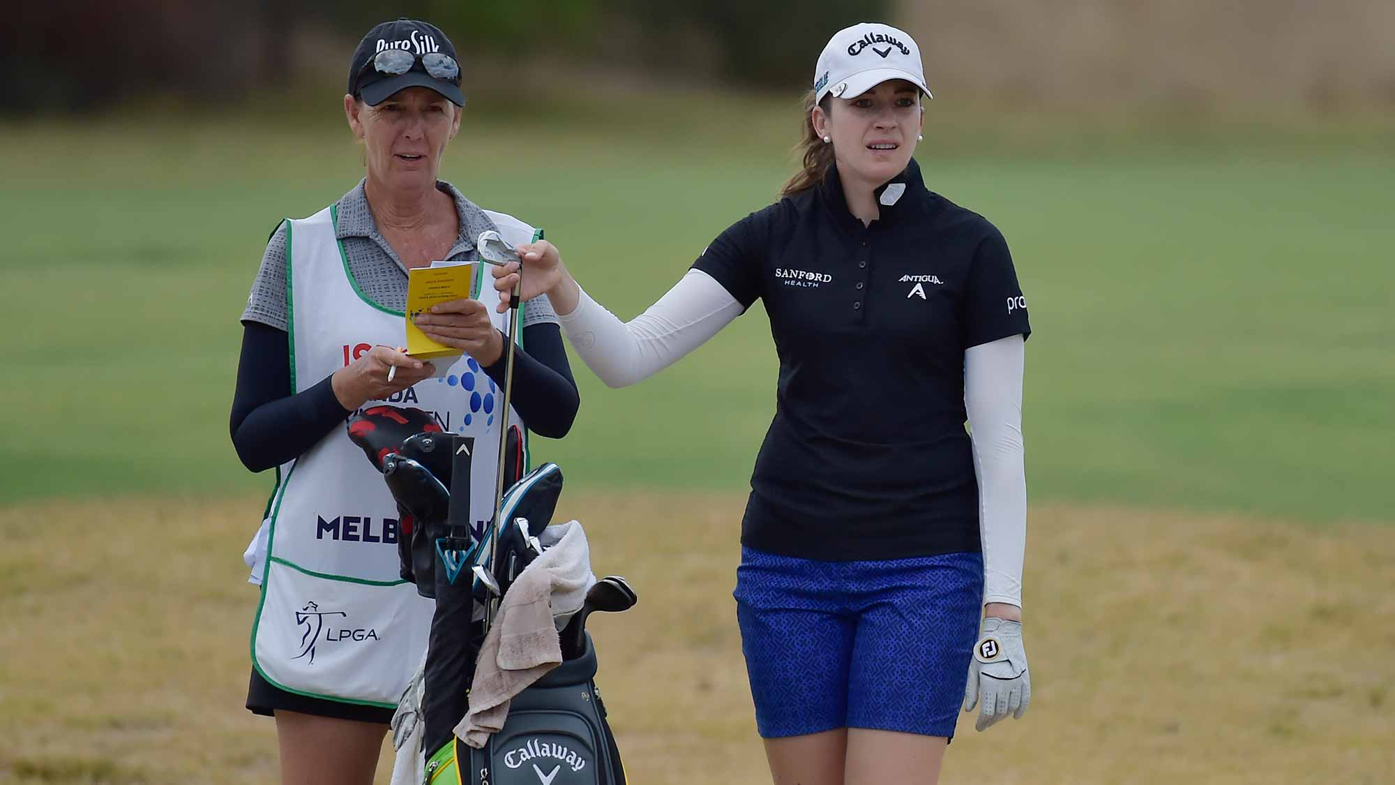 Kim Kaufman stands with her caddie during the second round of the ISPS Handa Vic Open in Geelong, Australia on February 8, 2019