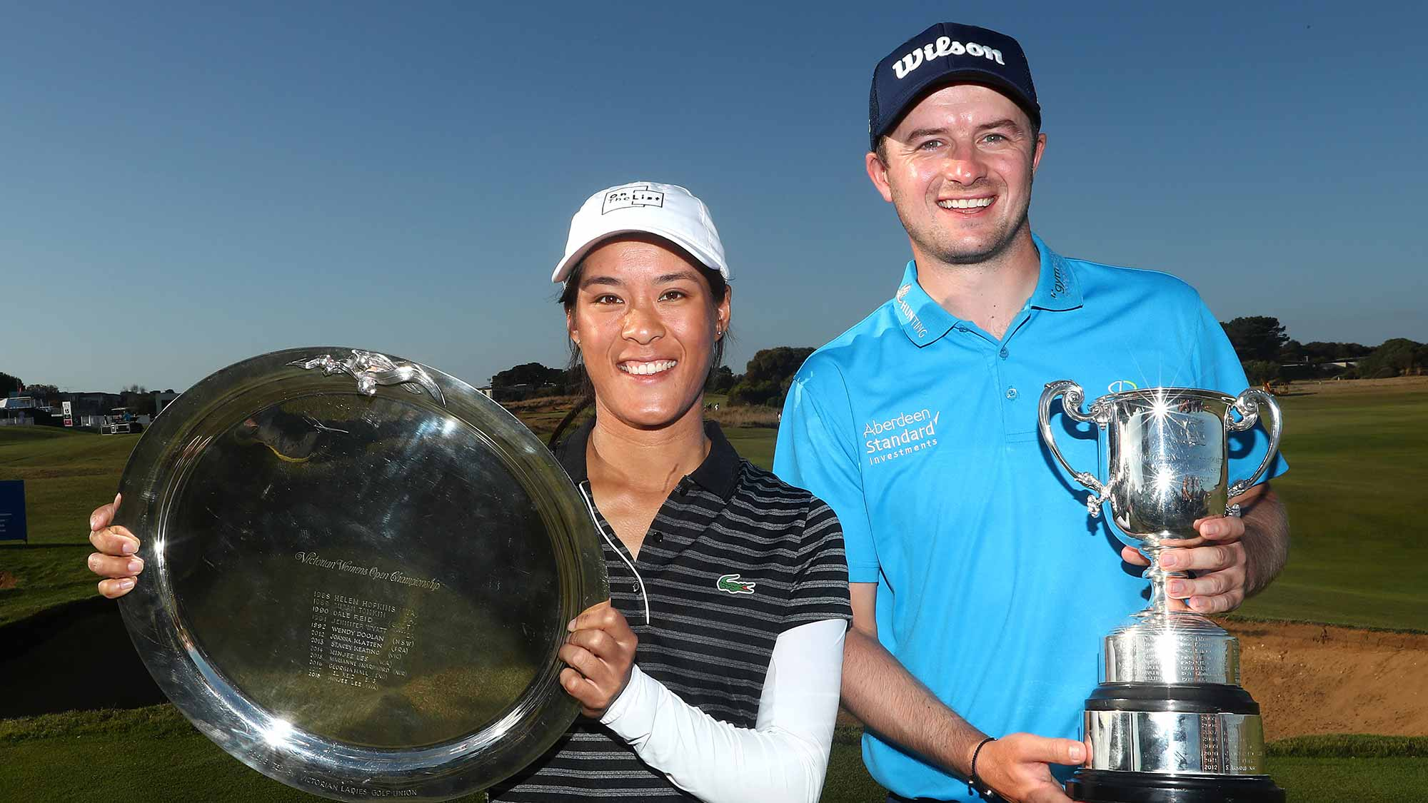Celine Boutier of France and David Law of Scotland pose with their winner's trophies during Day four of the ISPS Handa Vic Open at 13th Beach Golf Club on February 10, 2019 in Geelong, Australia