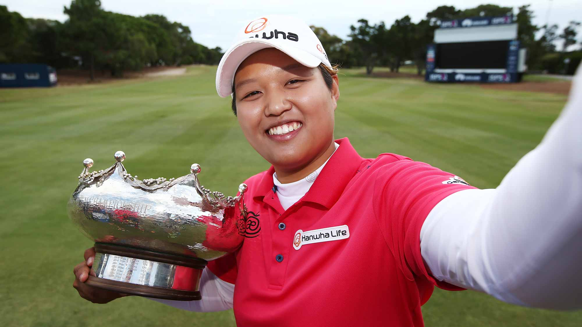 Haru Nomura of Japan pretends to take a selfie with the trophy after she won the Women's Australian Open on day four of the ISPS Handa Women's Australian Open
