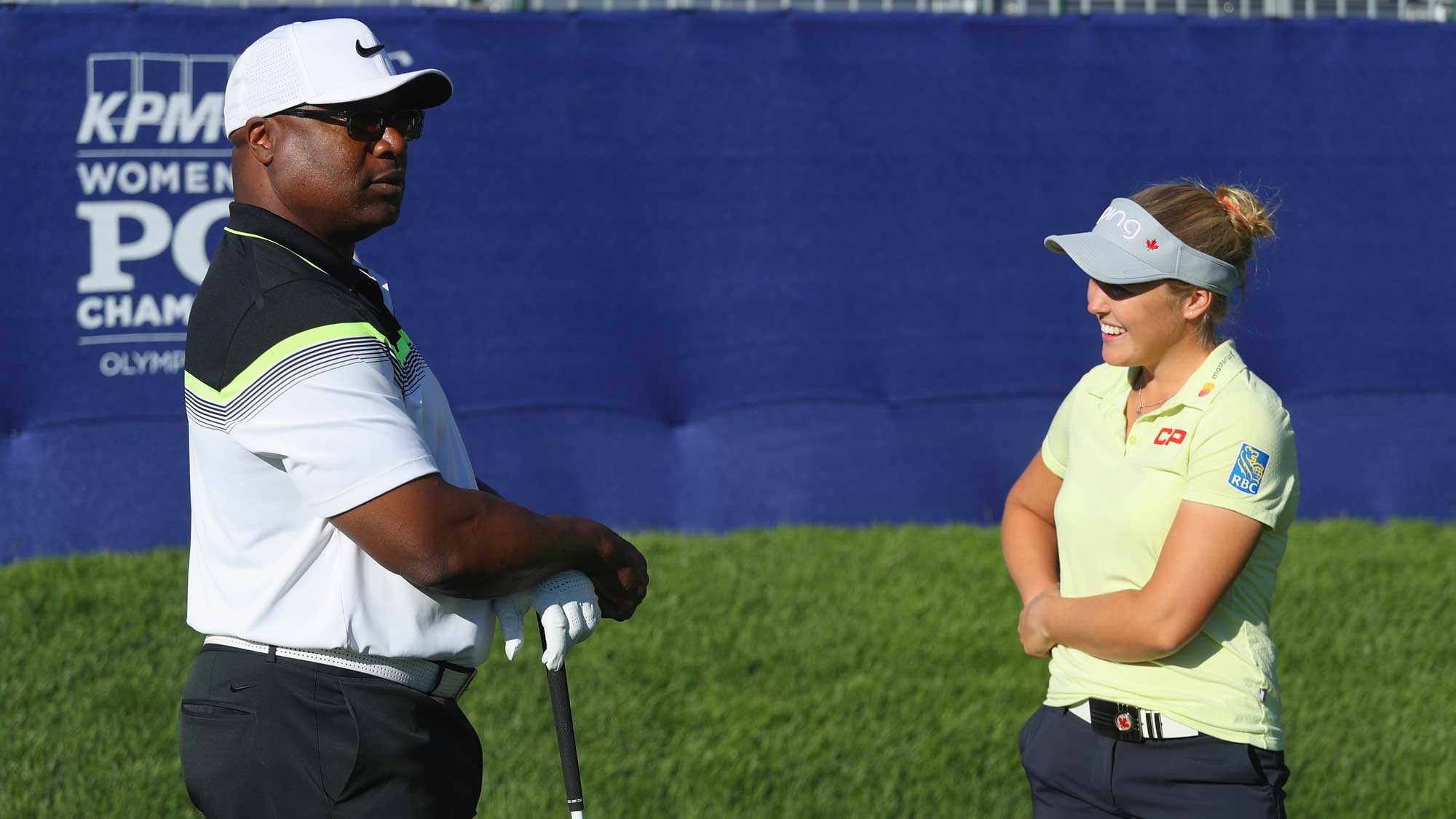 Former NFL star Bo Jackson (L) chats with Brooke Henderson of Canada during the pro-am prior to the start of the 2017 KPMG Women's PGA Championship