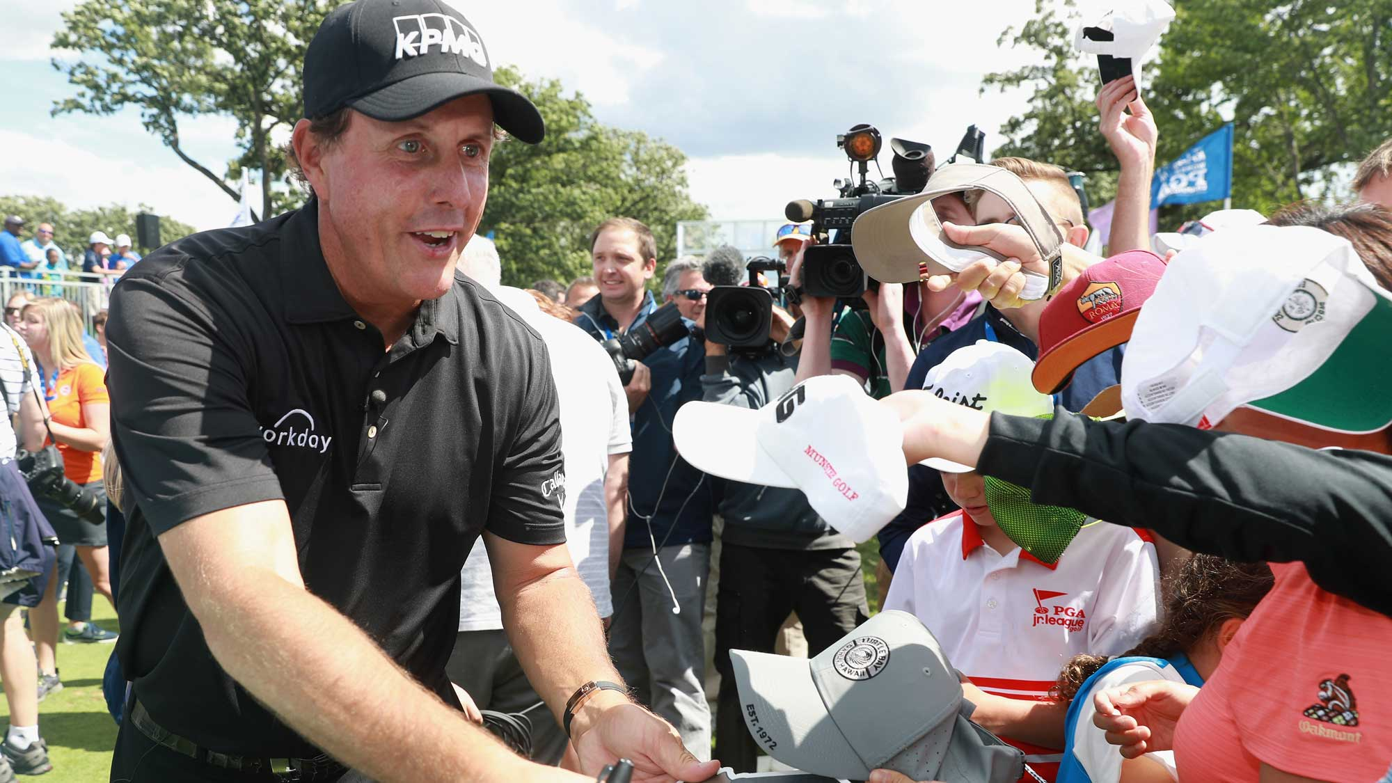 Phil Mickelson signs autographs for fans during a skills challenge prior to the start of the 2017 KPMG Women's PGA Championship