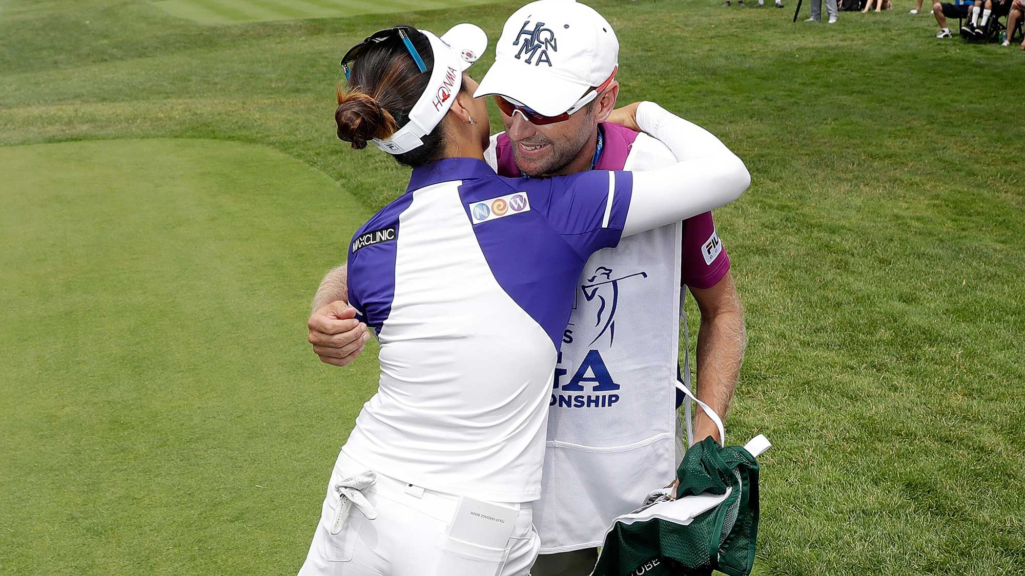 So Yeon Ryu of South Korea hugs her caddie, Tom Watson, after giving him a caddie bib signifying her #1 world ranking during the first round of the 2017 KPMG PGA Championship