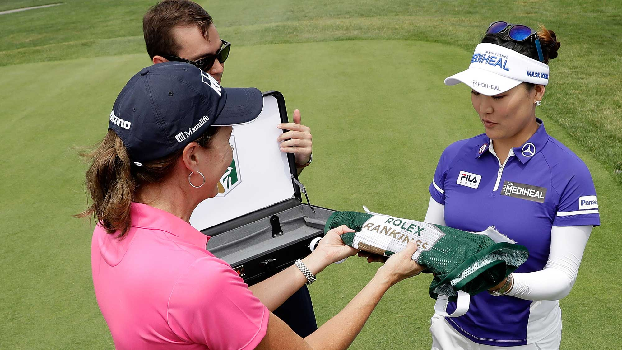 Lynne Doughtie Chairman and CEO of KPMG U.S. presents So Yeon Ryu of South Korea a caddie bib signifying her #1 world ranking during the first round of the 2017 KPMG PGA Championship