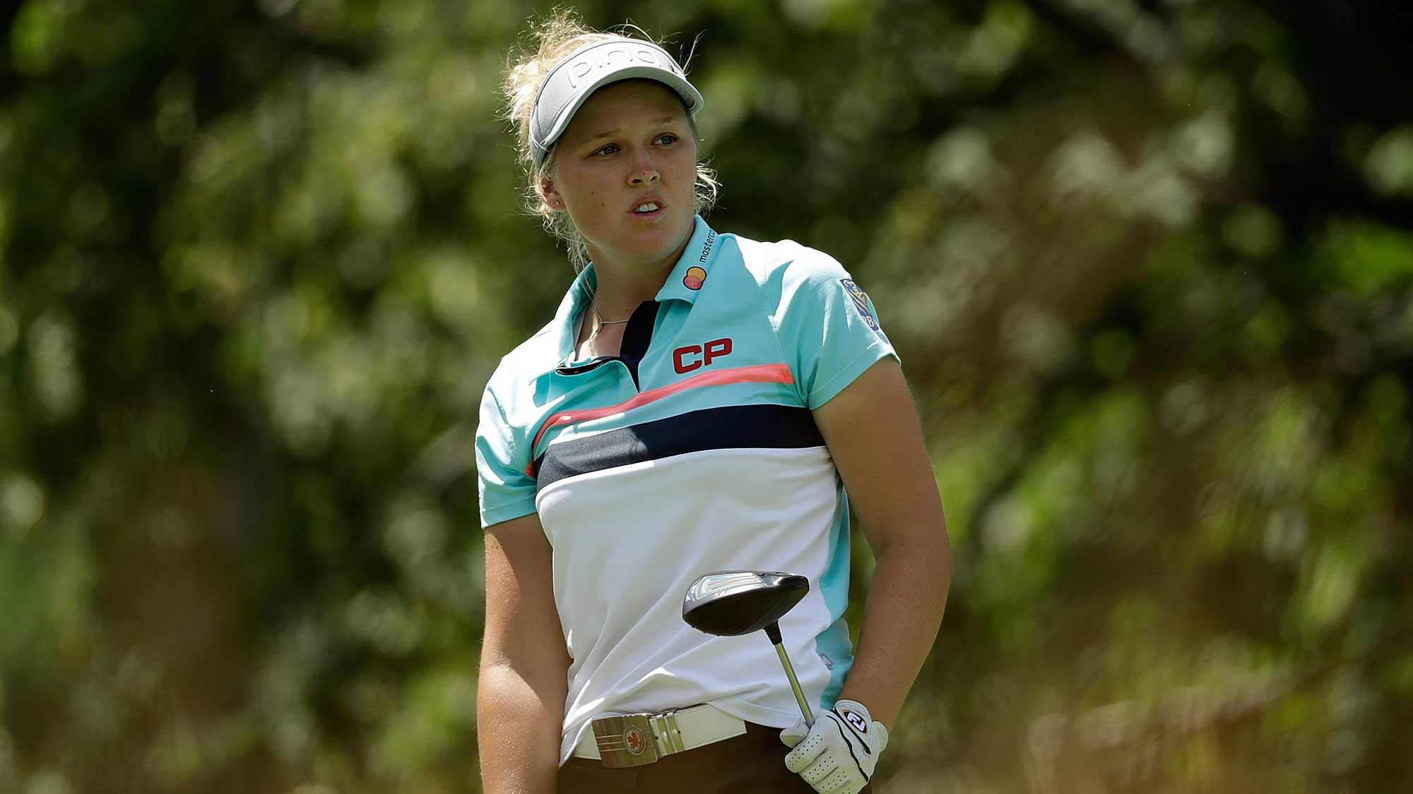 Brooke Henderson of Canada watches her tee shot on the fifth hole during the third round of the 2017 KPMG PGA Championship