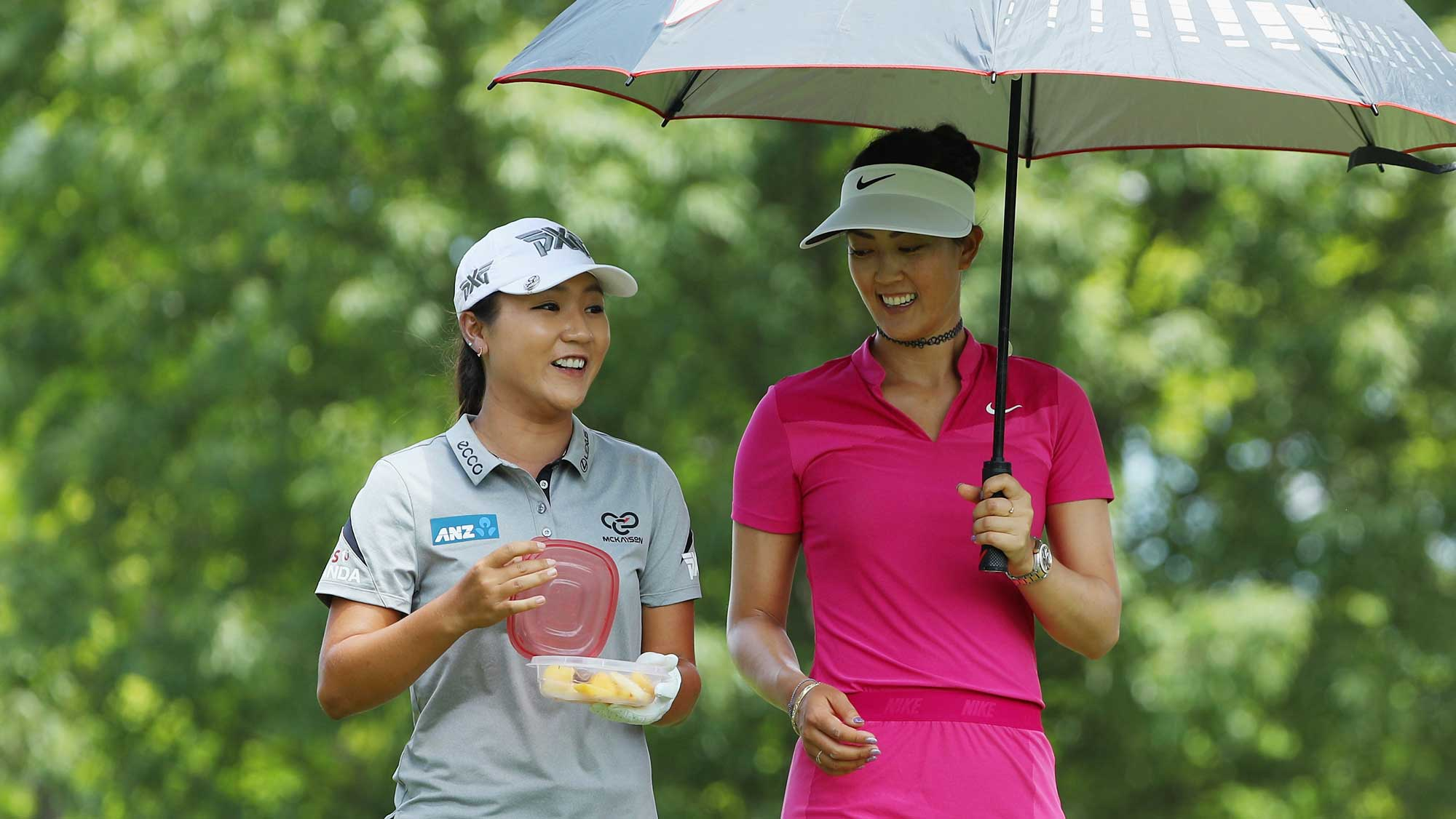 Michelle Wie and Lydia Ko of New Zealand wait together on the ninth hole during the third round of the 2017 KPMG Women's PGA Championship