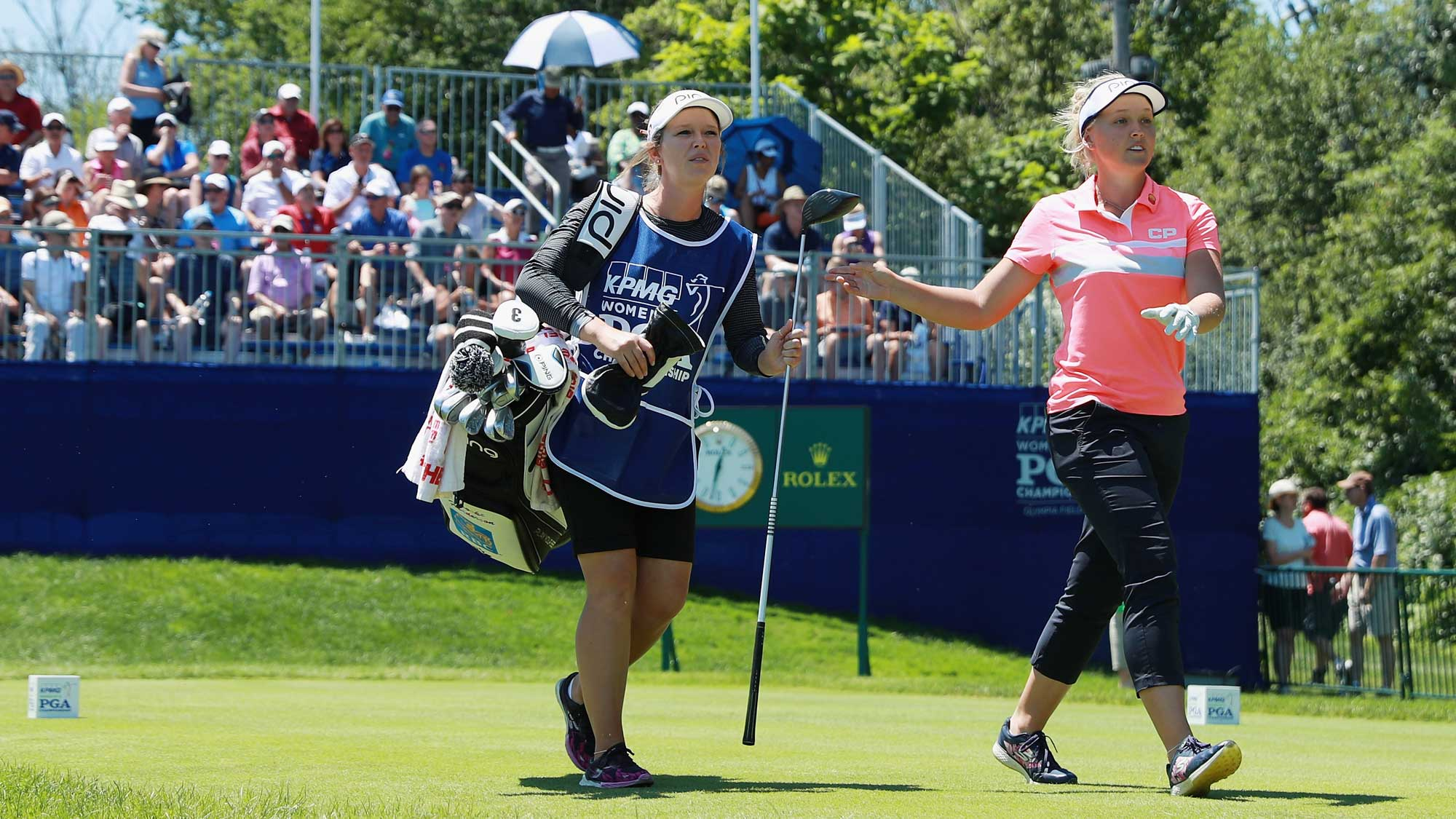 Brooke Henderson of Canada walks off the first tee alongside her sister/caddie Brittany during the final round of the 2017 KPMG Women's PGA Championship