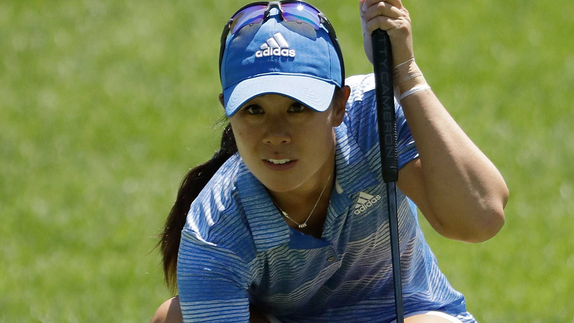 Danielle Kang lines up a putt on the fourth green during the final round of the 2017 KPMG PGA Championship