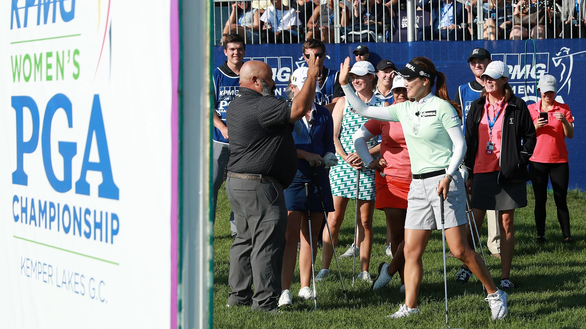 So Yeon Ryu high fives ESPN's Michael Collins during the KPMG Women's KPGA Championship Skills Challenge