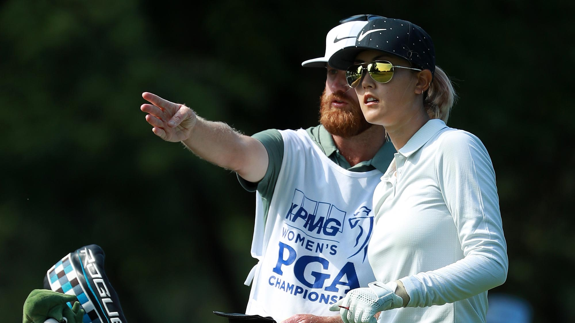 Michelle Wie lines up her tee shot with her caddie on the fifth hole during the first round of the KPMG Women's PGA Championship