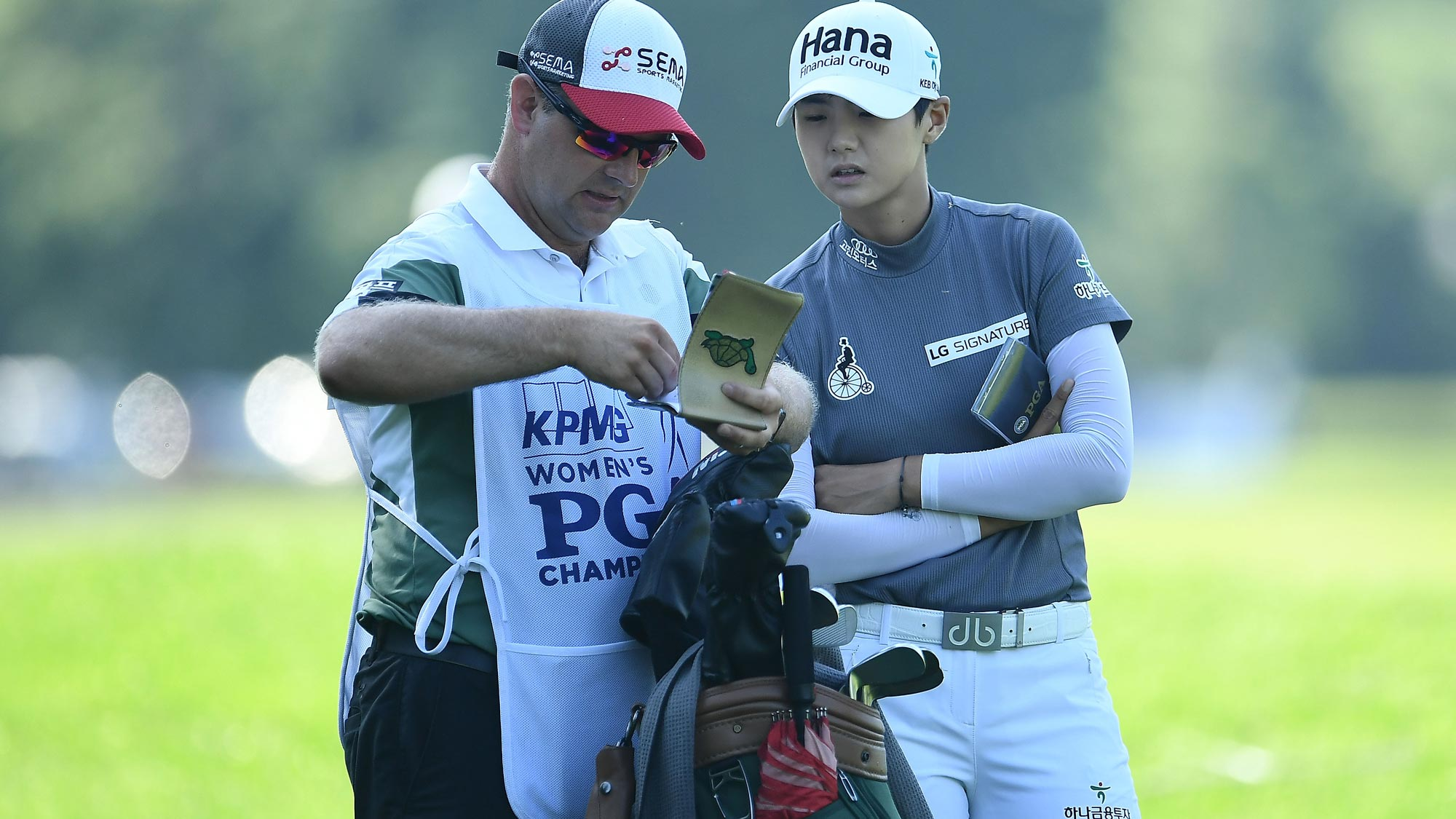 Sung Hyun Park of Korea speaks with her caddie on the 10th hole during the second round of the KPMG Women's PGA Championship
