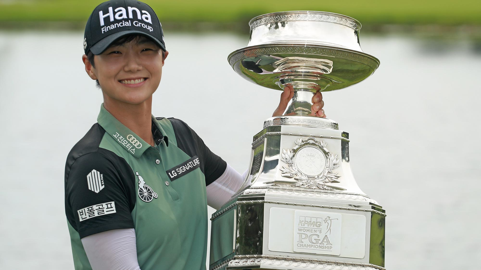Sung Hyun Park of South Korea celebrates with the trophy after winning the KPMG Women's PGA Championship at Kemper Lakes Golf Club