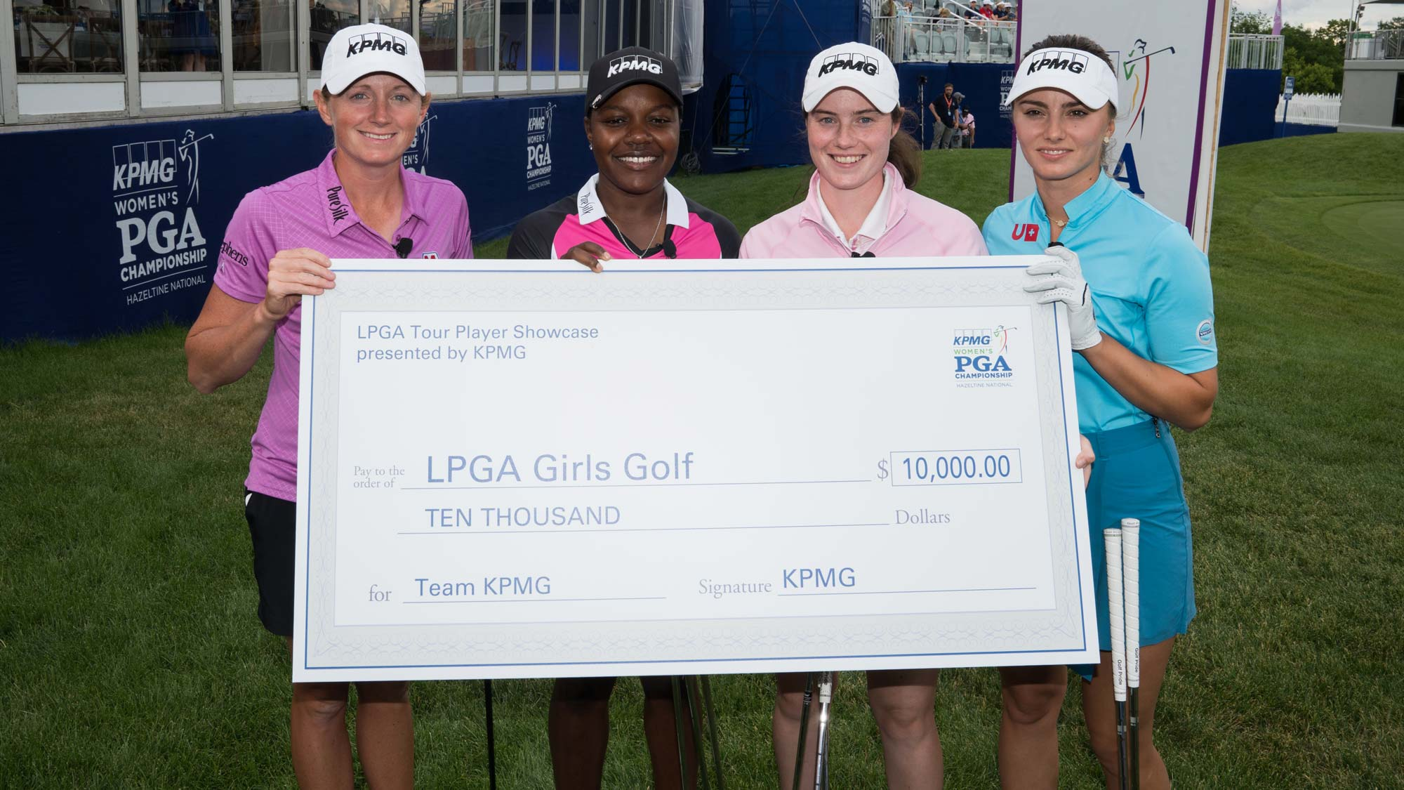 Stacy Lewis, Mariah Stackhouse, Leona Maguire and Klara Spilkova pose for a photo with the winning check during the KPMG Player Showcase for the 65th KPMG Women's PGA Championship