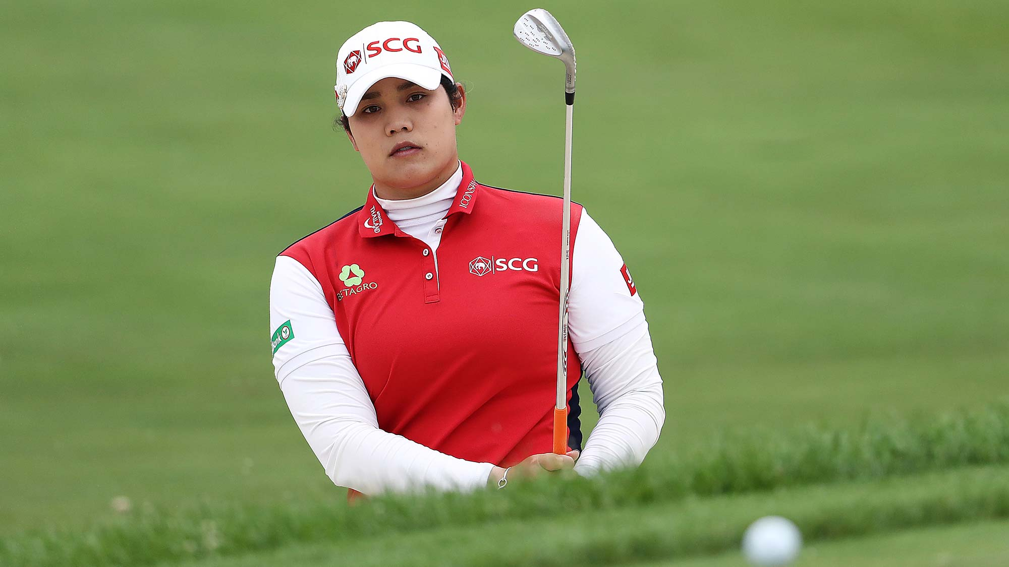 Ariya Jutanugarn of Thailand hits her third shot on the 1st hole from a bunker during the third round of the KPMG Women's PGA Championship