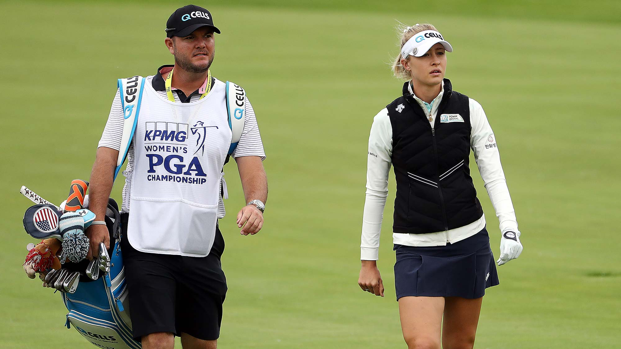 Nelly Korda walks up the fairway with her caddie on the 1st hole during the third round of the KPMG Women's PGA Championship
