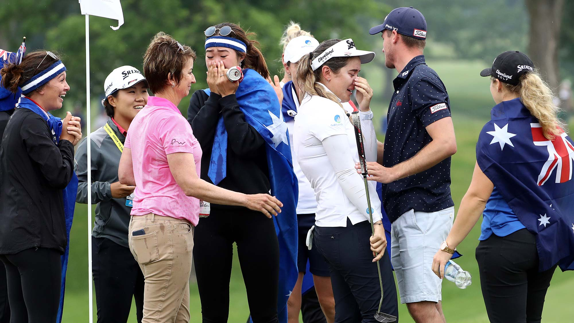 Hannah Green of Australia is swarmed by friends on the green after winning the KPMG Women's PGA Championship at Hazeltine National Golf Course