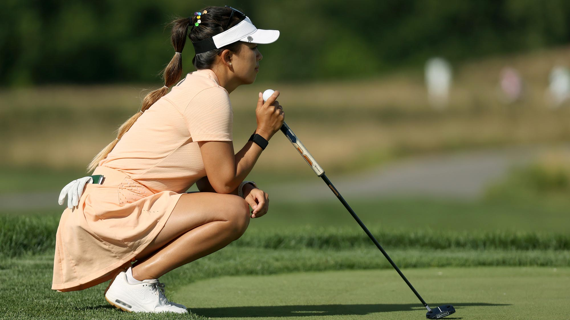 Brianna Do lines up a putt on the fifth green during the first round of the LPGA Drive On Championship