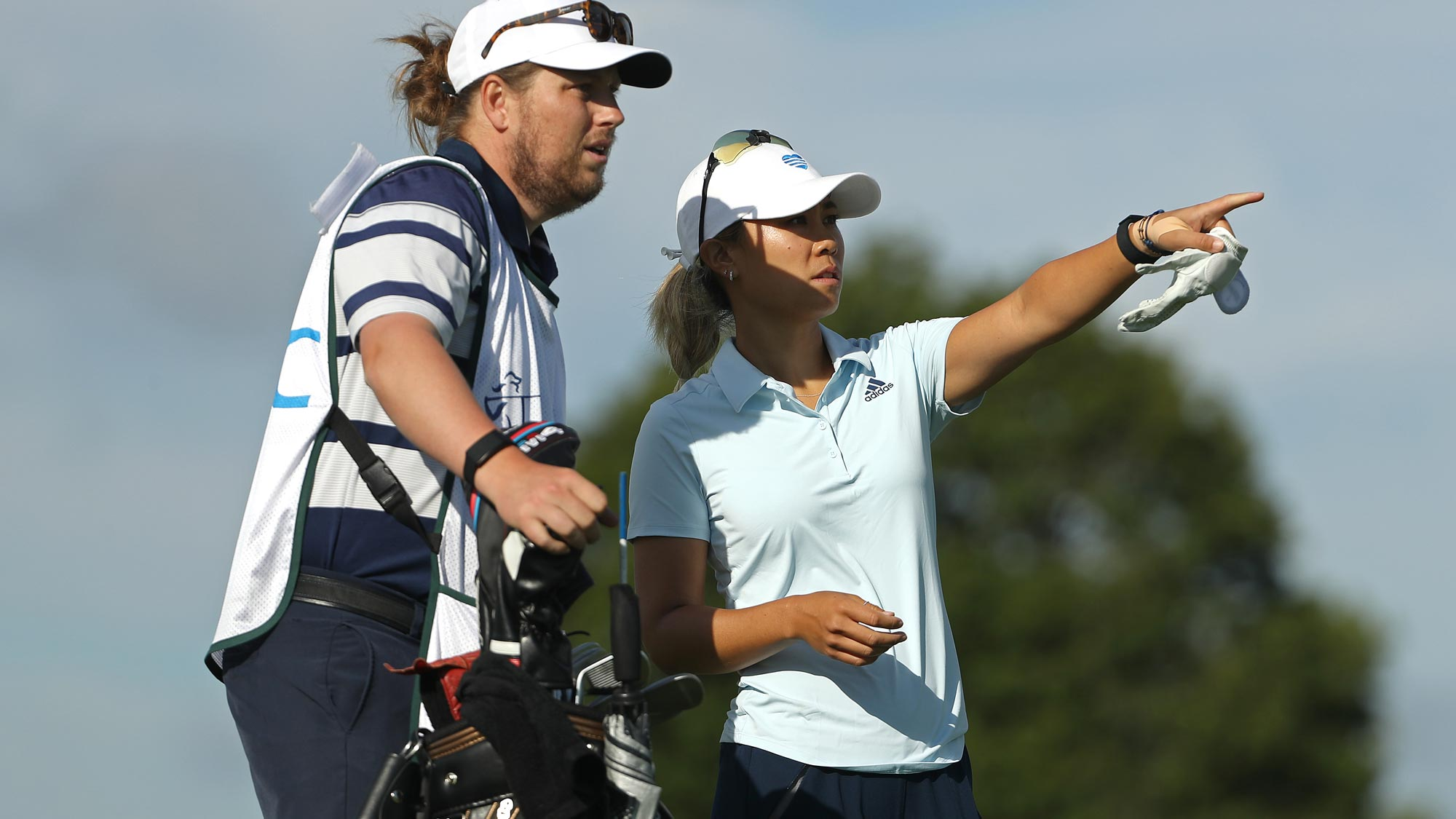 Danielle Kang prepares to play her shot from the 15th tee during the first round of the LPGA Drive On Championship