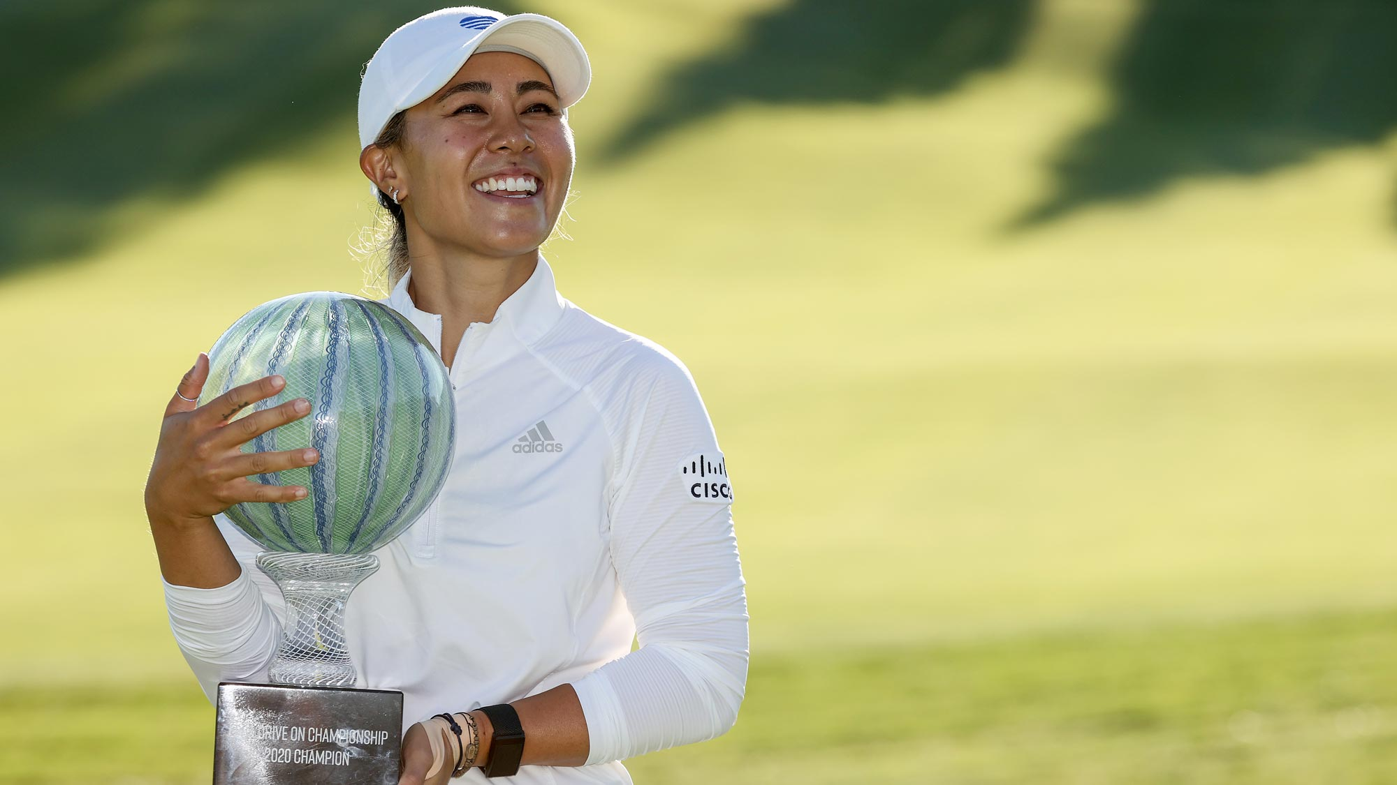Danielle Kang celebrates with the trophy on the 18th green after her -7 under par final round victory in the LPGA Drive On Championship