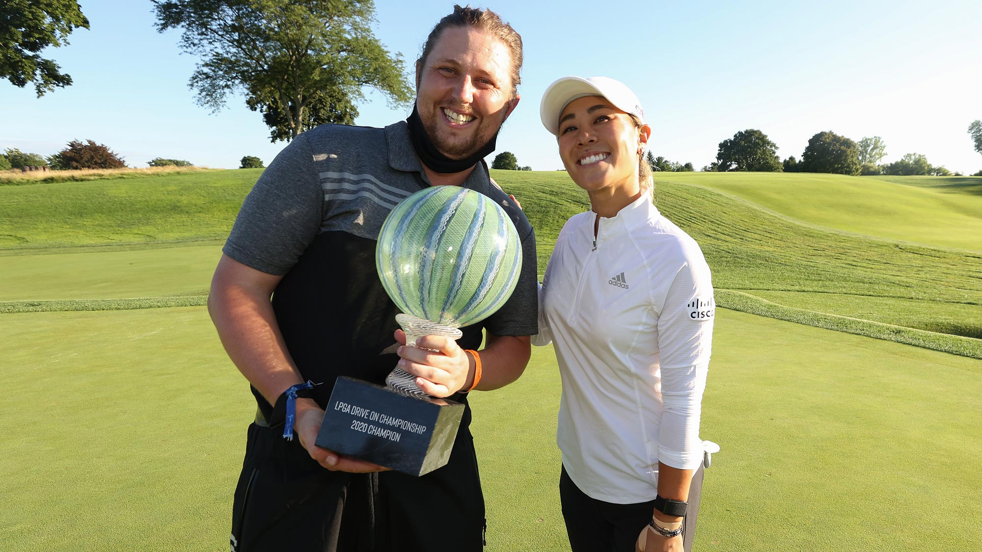 Danielle Kang celebrates with her caddie, Oliver Brett, after her -7 under par final round victory in the LPGA Drive On Championship