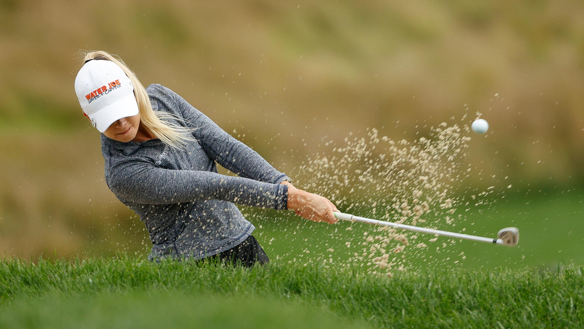 Sarah Burnham plays a shot from a bunker on the 12th hole during the final round of the LPGA Drive On Championship