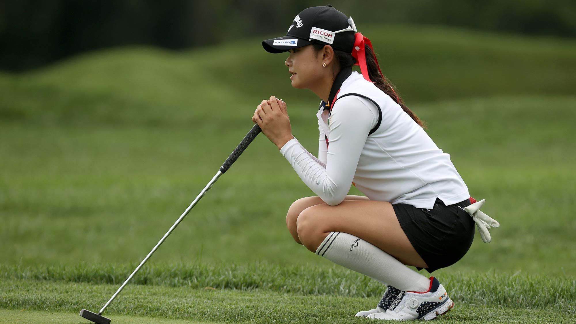 Yui Kawamoto of Japan lines up a putt on the 13th green during the final round of the LPGA Drive On Championship