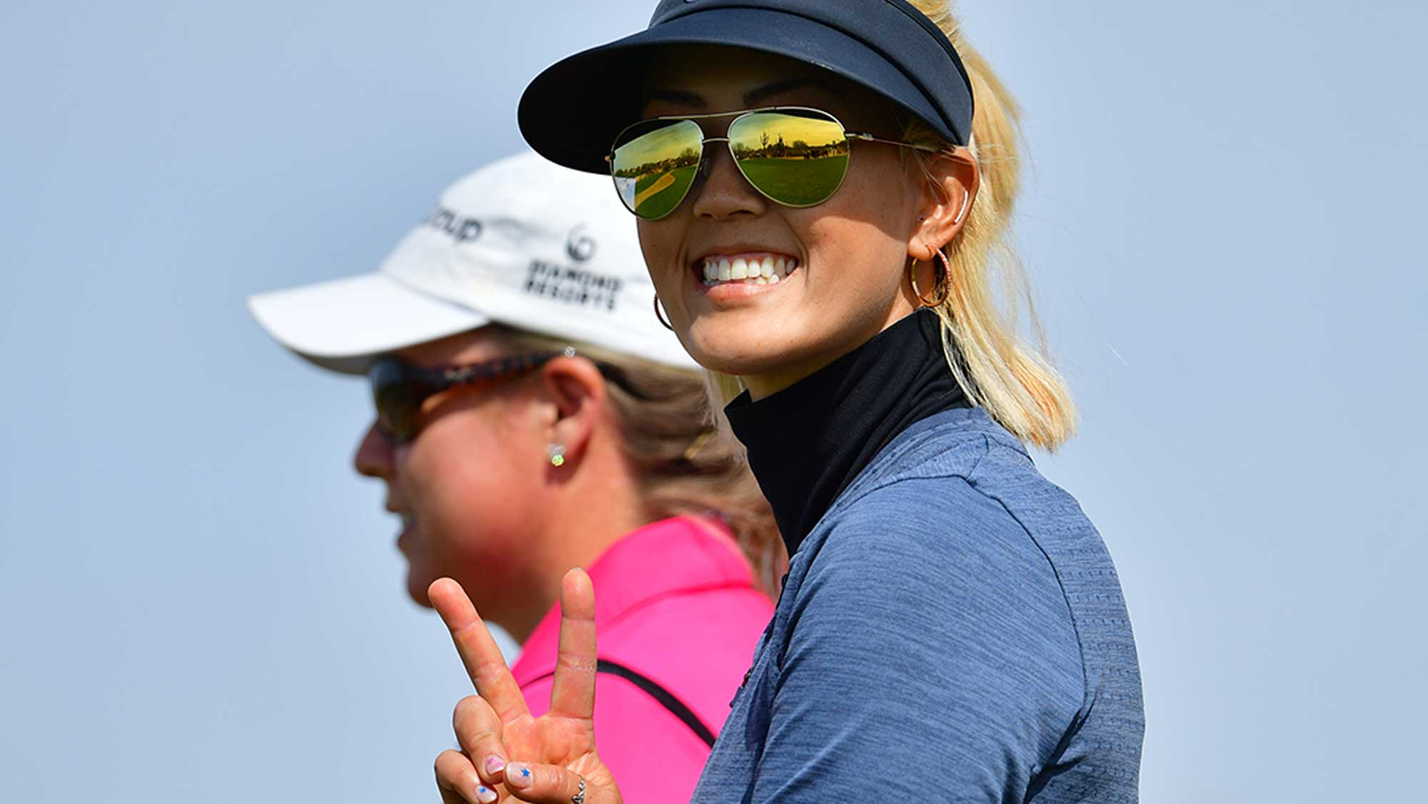 Michelle Wie Gives the Peace Sign to the Camera