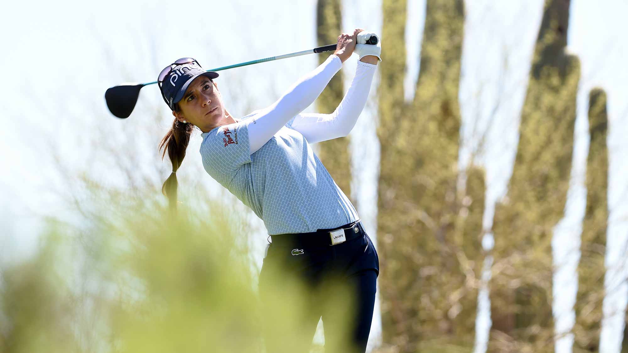 Azahara Munoz of Spain hits her tee shot on the 13th holeduring the third round of the Bank Of Hope Founders Cup at the Wildfire Golf Club on March 23, 2019 in Phoenix, Arizona