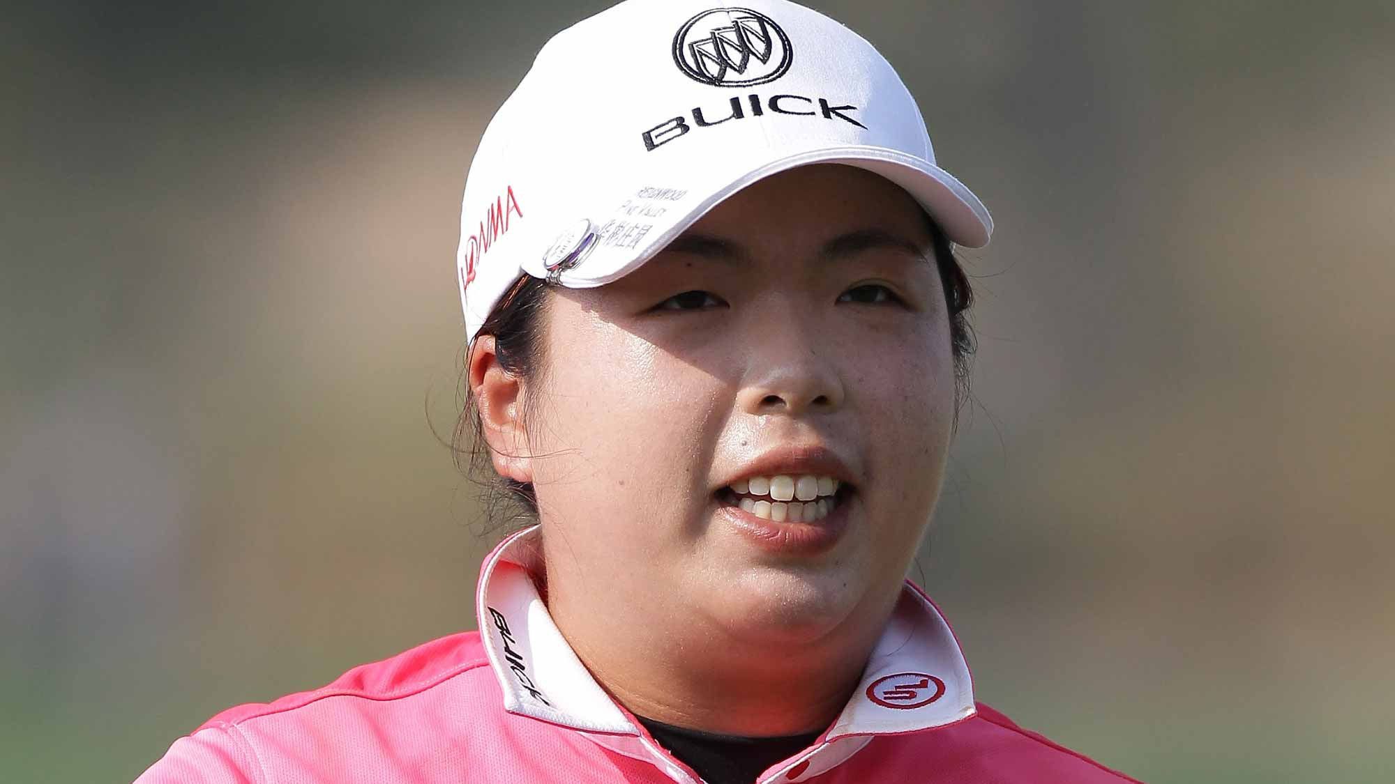 Shanshan Feng of China reacts after a putt on the 18th green during the first round of LPGA KEB Hana Bank Championship at Sky 72 Golf Club Ocean Course