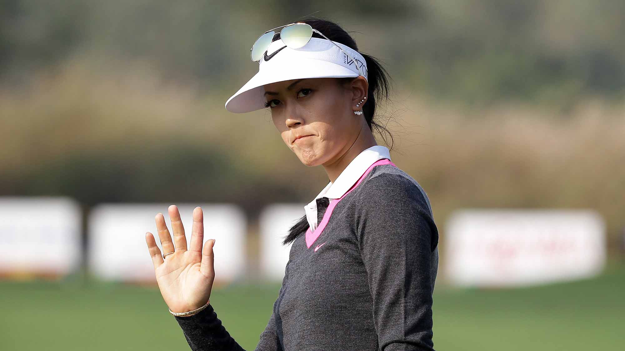 Michelle Wie of United States reacts after a putt on the 18th green during the first round of LPGA KEB Hana Bank Championship at Sky 72 Golf Club Ocean Course