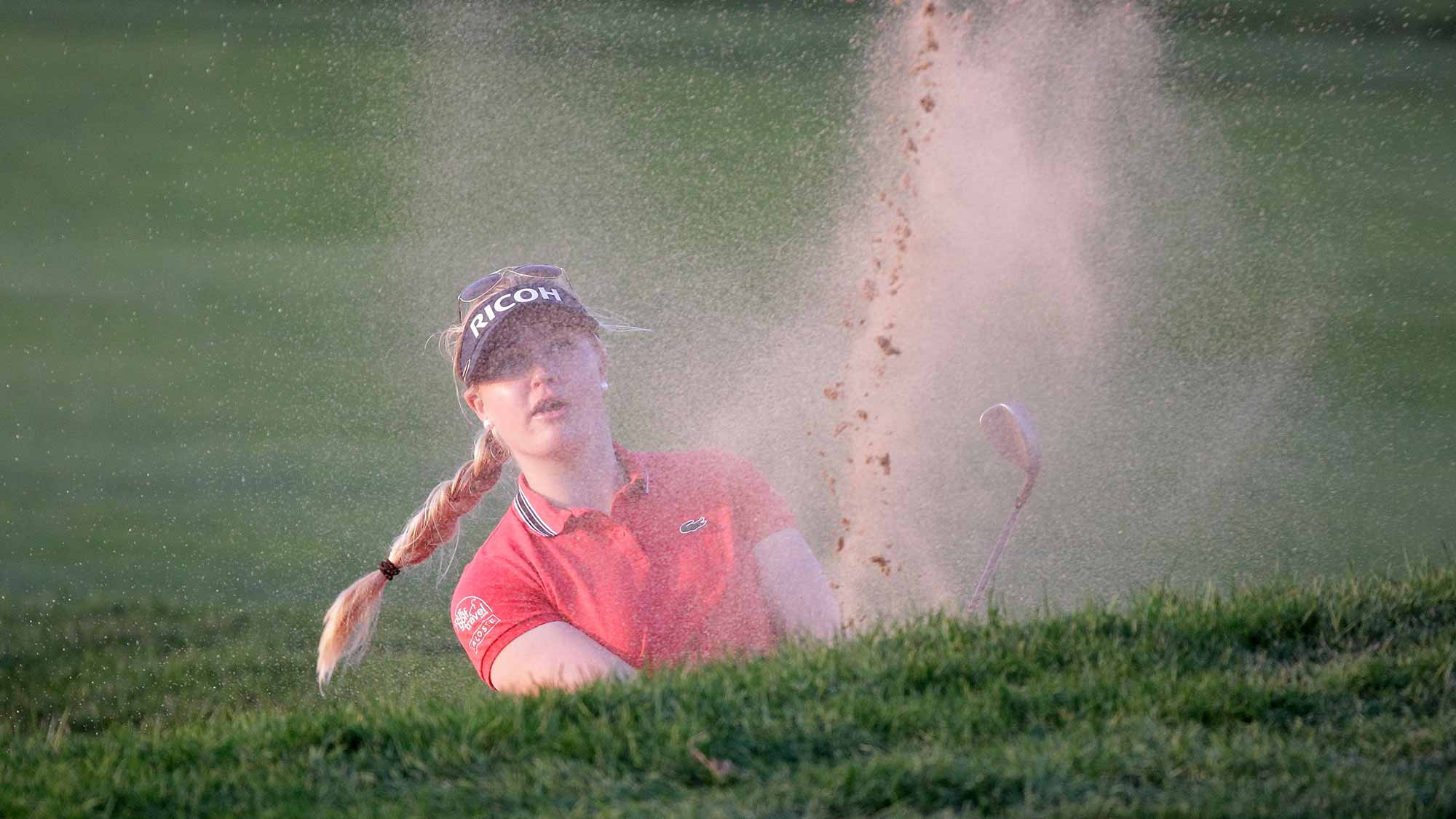 Charley Hull of England plays a bunker shot on the 18th hole during round two of the LPGA KEB Hana Bank Championship
