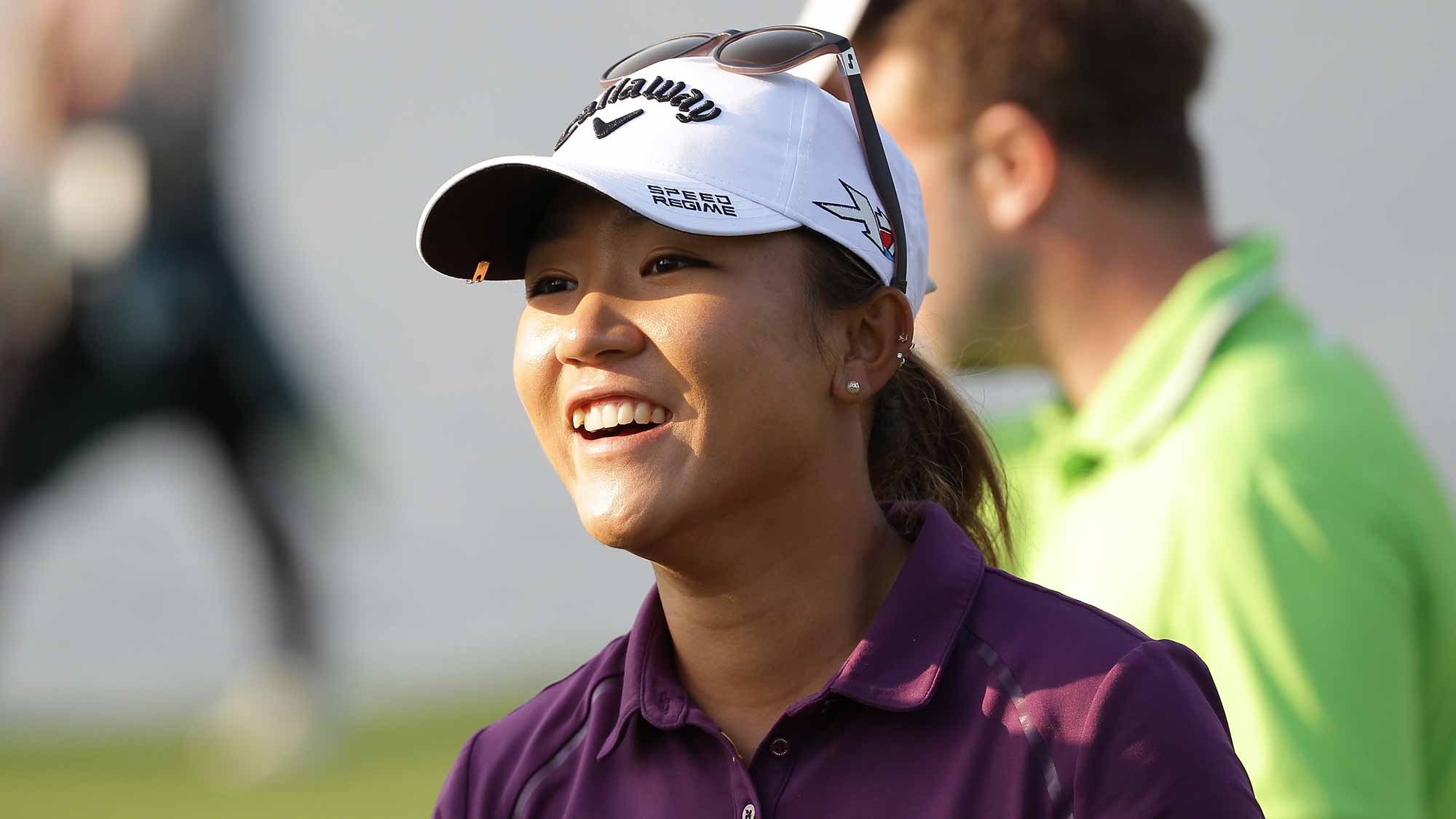 Lydia Ko of New Zealand reacts after a birdie putt on the 18th green during round two of the LPGA KEB Hana Bank Championship