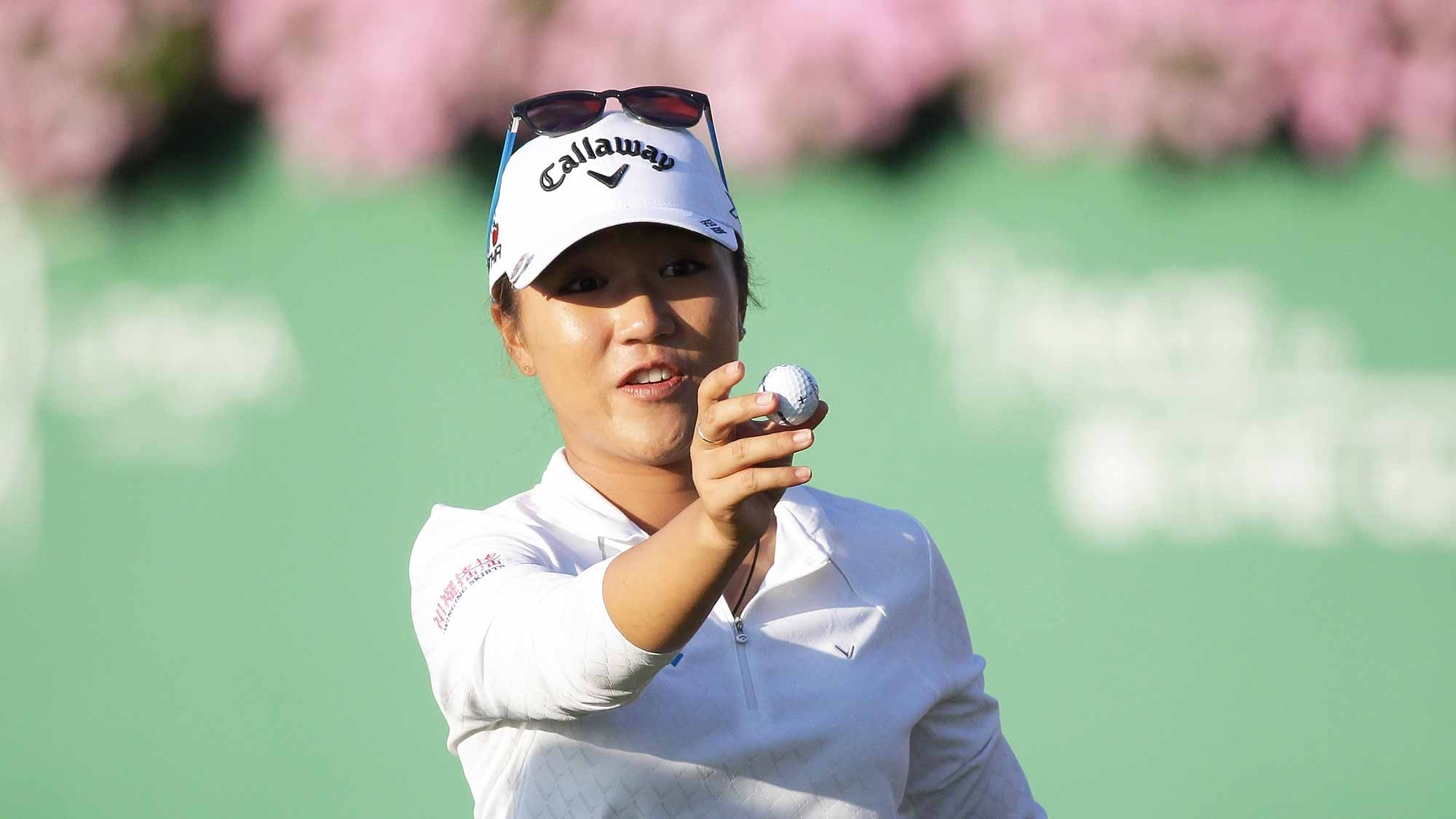 Lydia Ko of New Zealand reacts after a putt on the 18th green during round three of the LPGA KEB Hana Bank