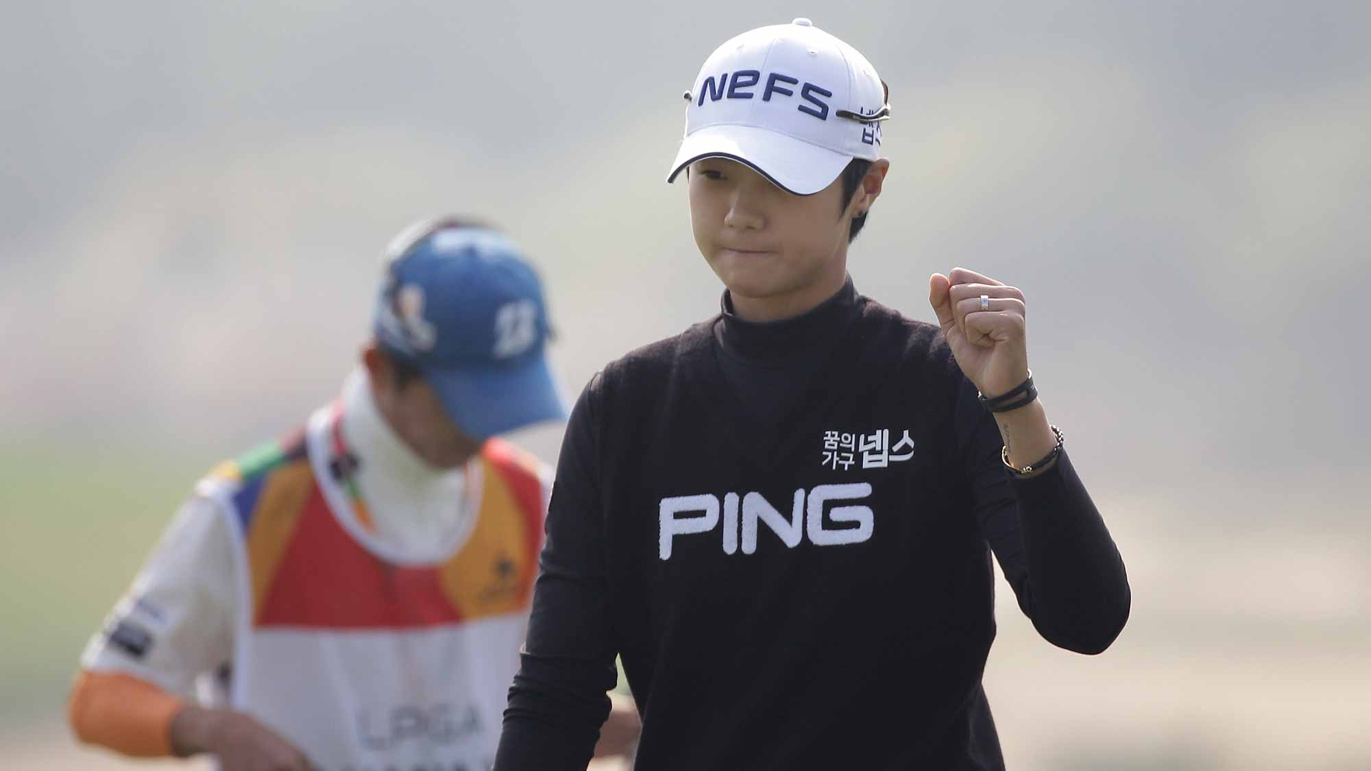 Sung Hyun Park of South Korea reacts after a putt on the 1st hole during round four of the LPGA KEB Hana Bank