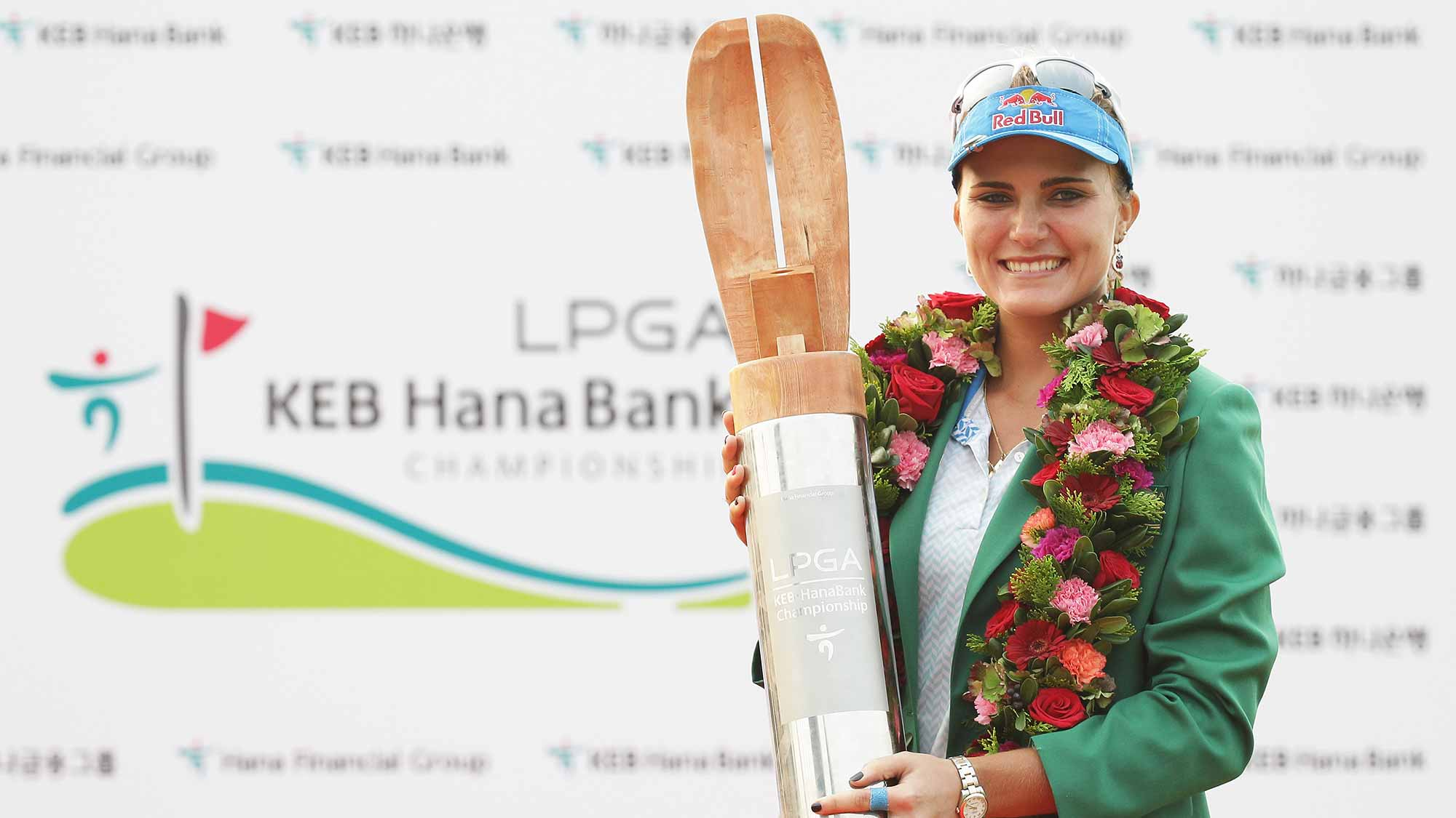 Lexi Thompson of United States lifts the winners trophy during a ceremony following the LPGA KEB Hana Bank