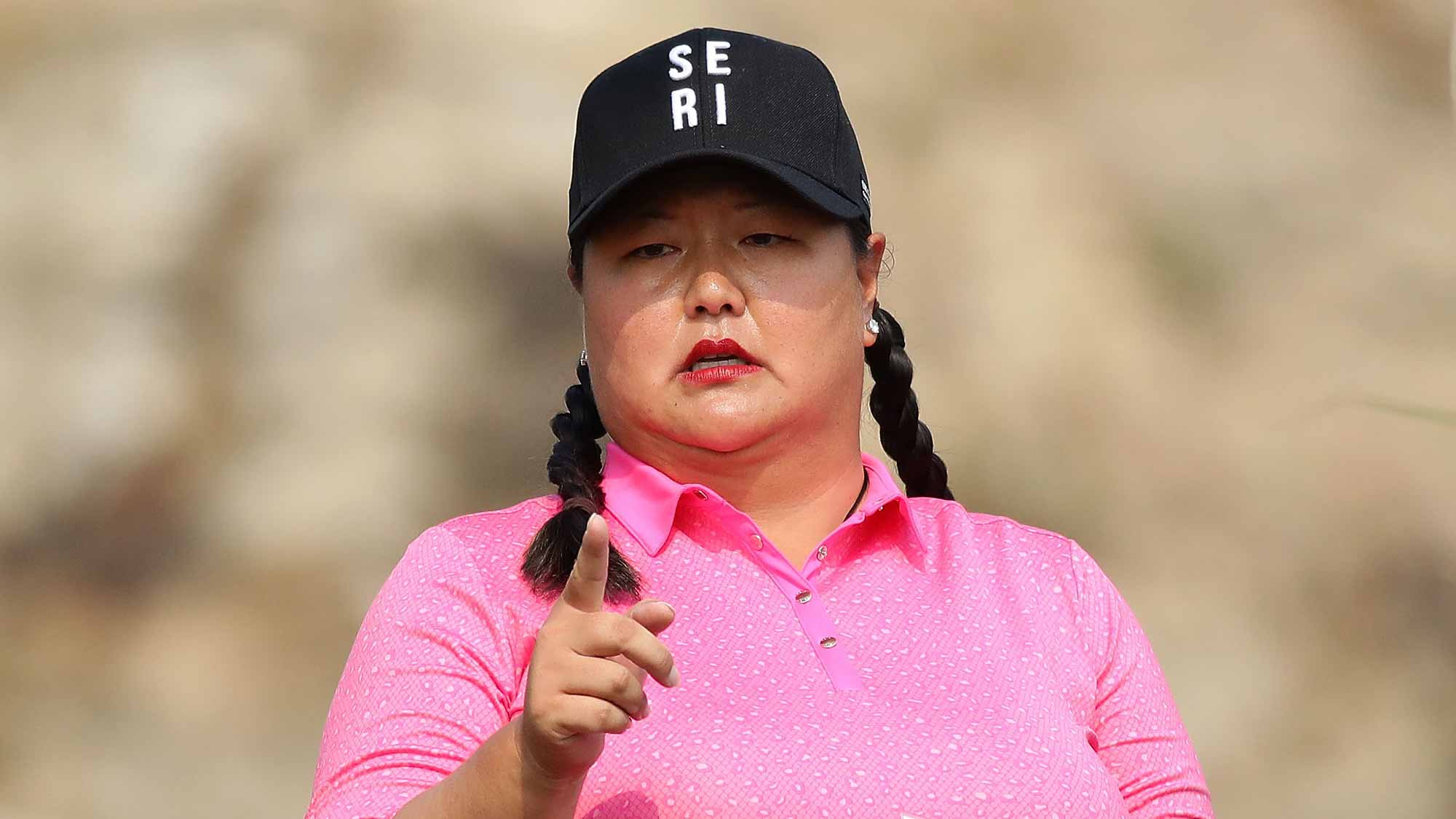 Christina Kim of United States wear Se-Ri Pak's hat on the 2nd hole during the second round of the LPGA KEB-Hana Bank Championship at the Sky 72 Golf Club Ocean Course