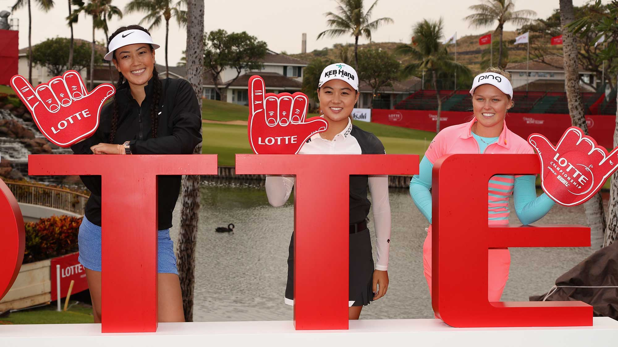(L-R) Michelle Wie, Minjee Lee and Brooke M. Henderson pose together at a photo call ahead of the LPGA LOTTE Championship Presented By Hershey at Ko Olina Golf Club