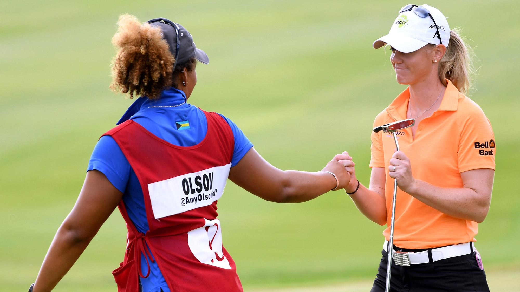 Amy Olson Celebrates with Her Caddy at LOTTE Championship